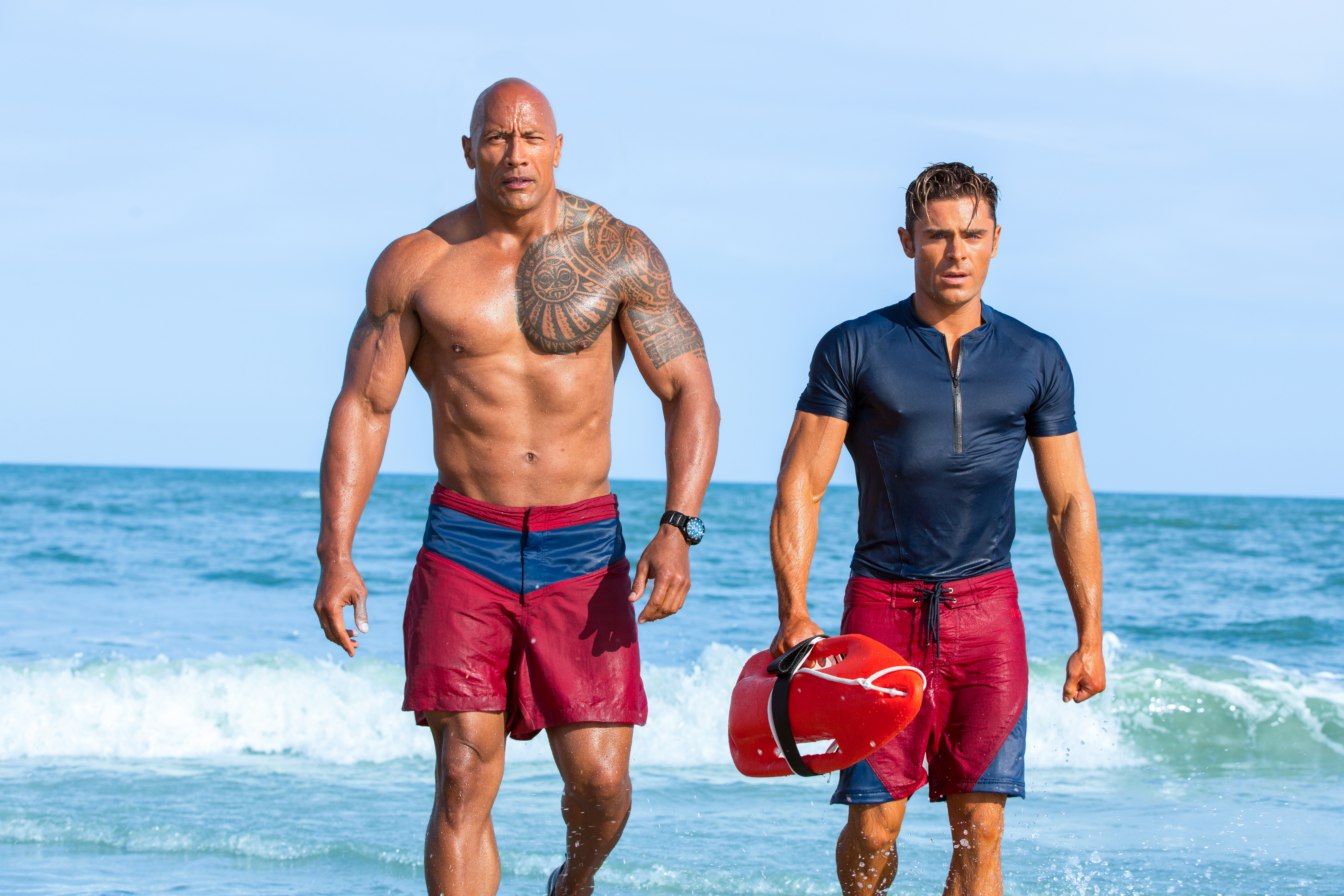 (L-R) Dwayne Johnson as Mitch Buchannon and Zac Efron as Matt Brody in BAYWATCH by Paramount Pictures, Montecito Picture Company, FlynnPicture Co., and Fremantle Productions