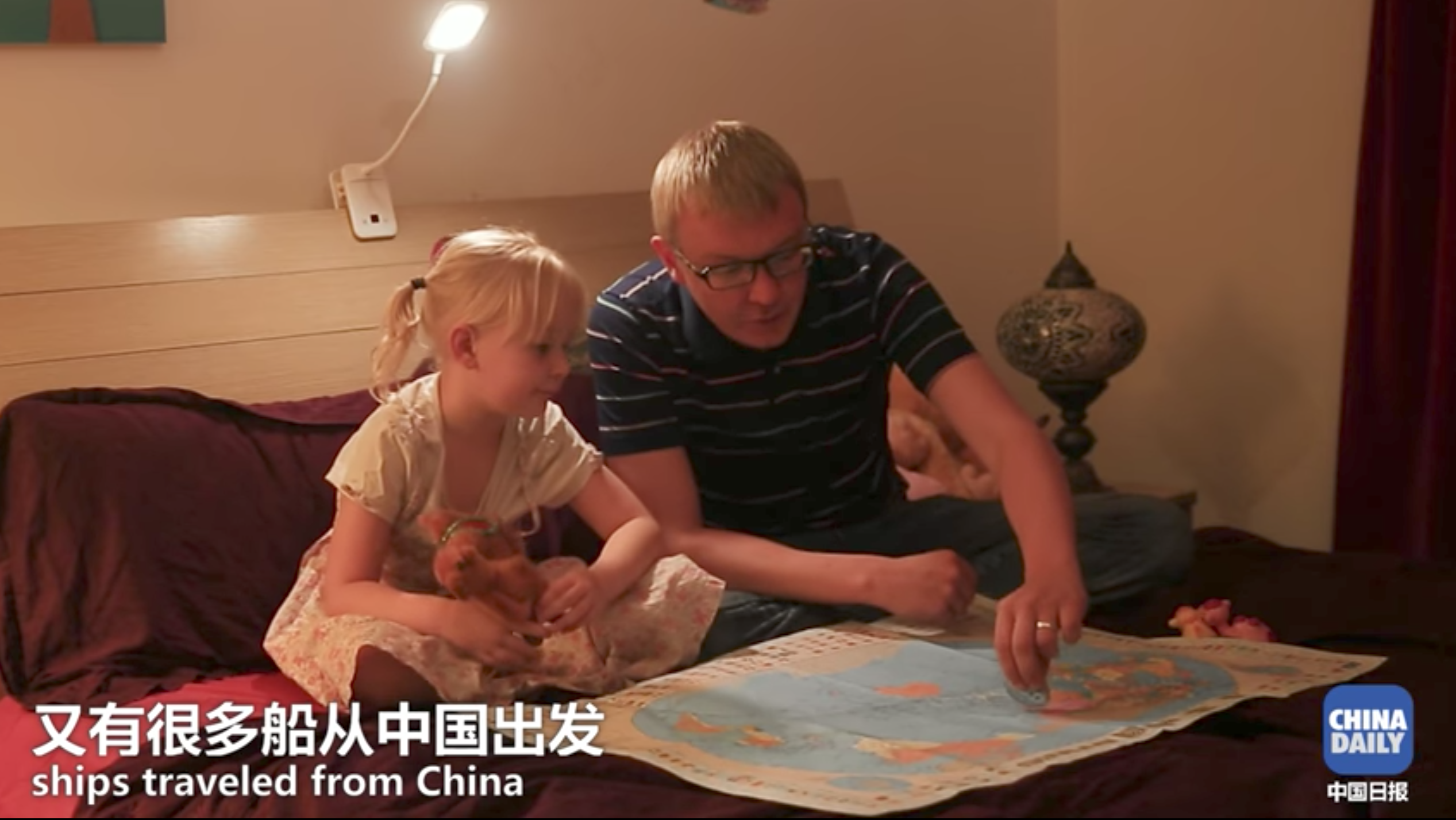 "American journalist Eric Nilsson working for China's state-owned media China Daily explains ""One Belt One Road"" to his five-year-old daughter"