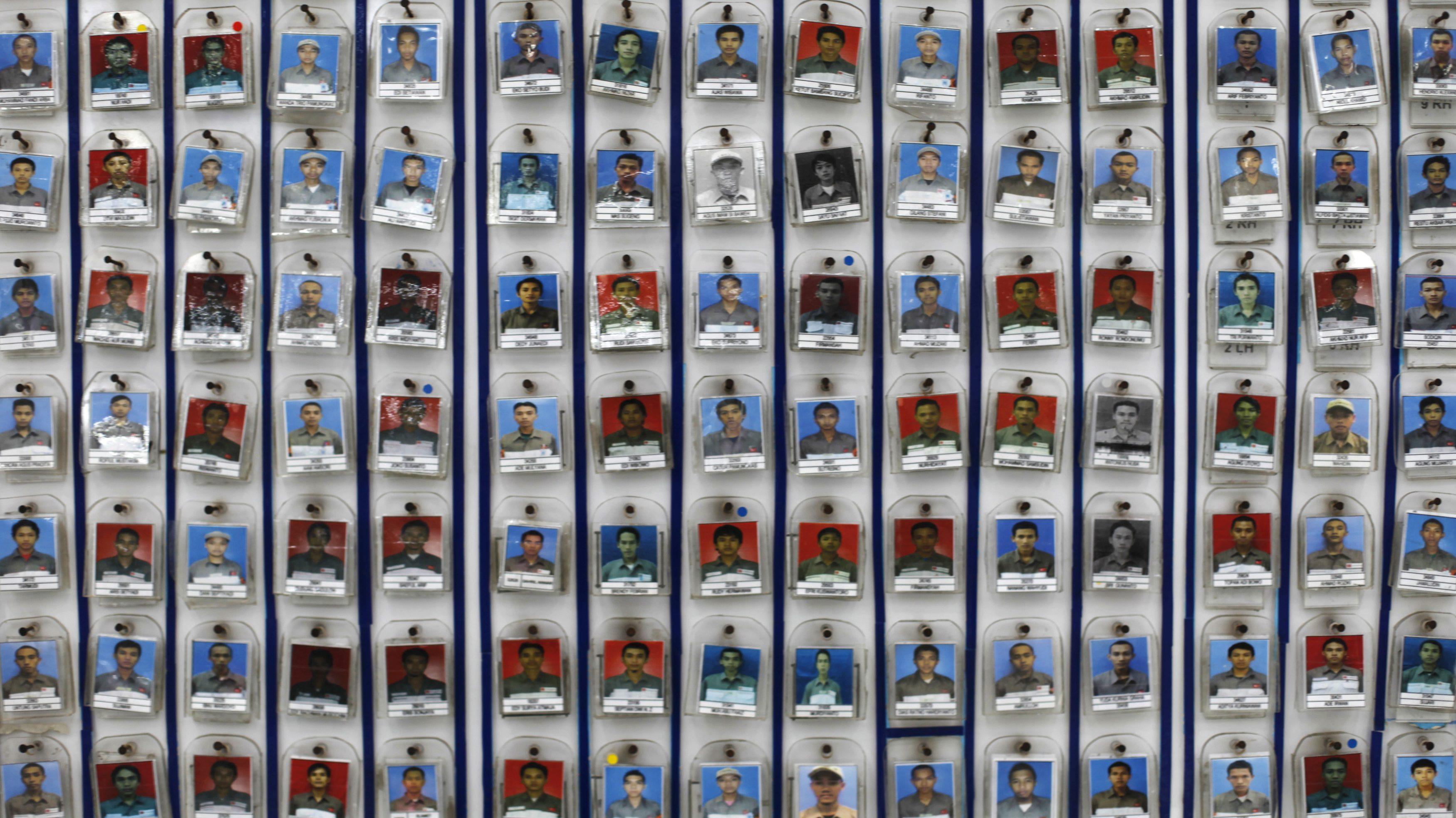Pictures of employees are arranged according to a work schedule displayed on a wall in the PT Astra Daihatsu assembly plant in Jakarta June 7, 2010. PT Astra International, Indonesia's biggest listed firm, sees 2010 vehicle sales rising to a record 650,000 units as low interest rates spur consumer demand and provided plans to hike car taxes are put off to 2011.