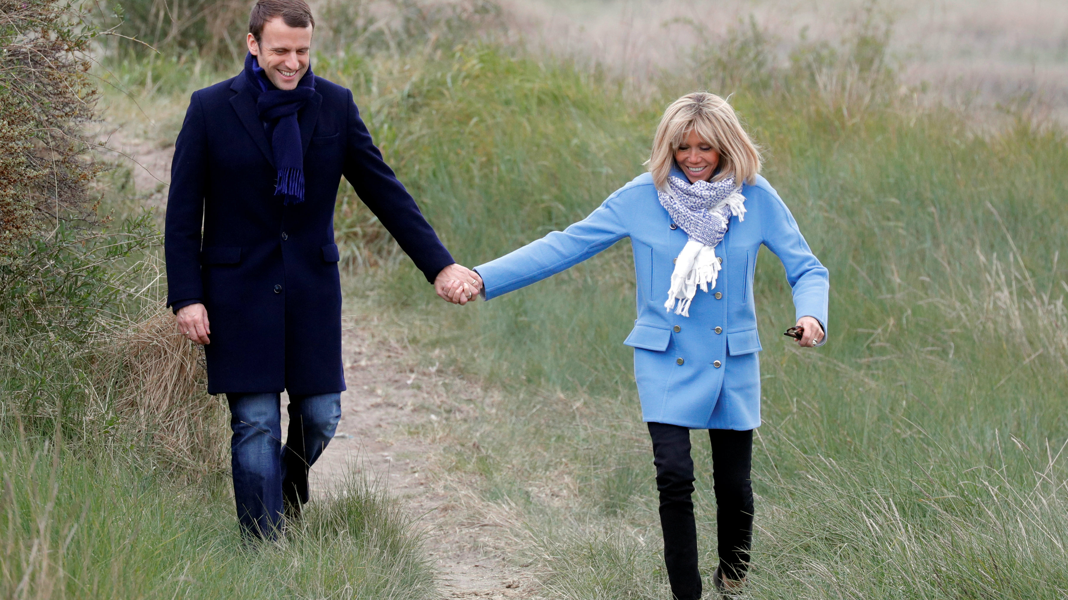 Emmanuel Macron, head of the political movement En Marche!, or Onwards!, and candidate for the 2017 French presidential election and his wife Brigitte Trogneux pose in countryside in Le Touquet, France, on the eve of France's first round of the Presidential election, April 22, 2017. REUTERS/Philippe Wojazer