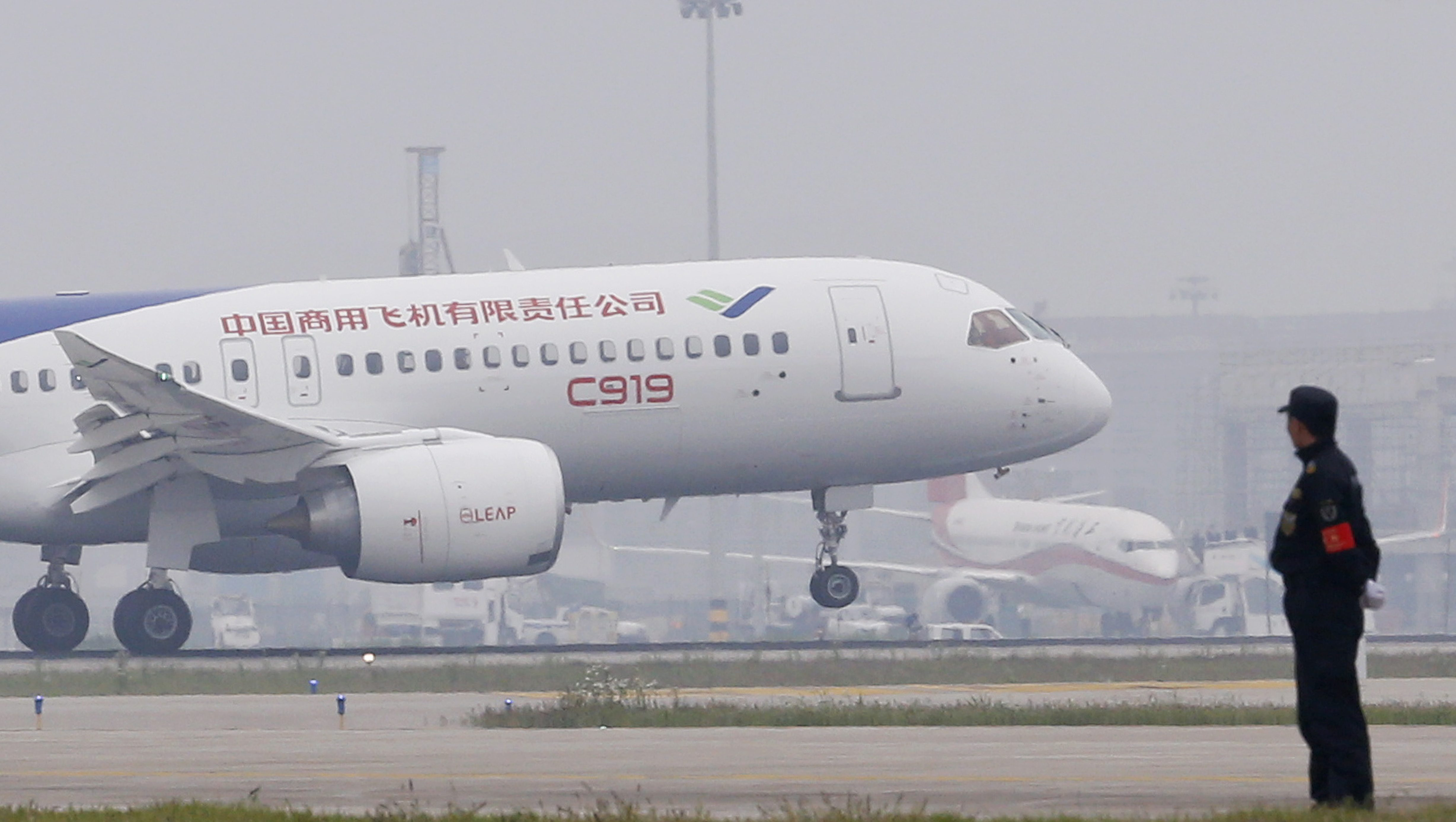 China's home-grown C919 passenger jet lands on its maiden flight at the Pudong International Airport in Shanghai, Friday, May 5, 2017. The first large Chinese-made passenger jetliner C919 took off Friday on its maiden flight, a symbolic milestone in China's long-term goal to break into the Western-dominated aircraft market. (Aly Song/Pool Photo via AP)