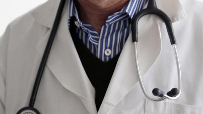 A photo illustration shows a French general practitioner with a stethoscope in a doctor's office in Bordeaux January 7, 2015. French physicians protest against a new health reform bill that would introduce a third party payment system. Picture taken January 7, 2015. REUTERS/Regis Duvignau (FRANCE - Tags: HEALTH POLITICS) - RTR4OCXQ