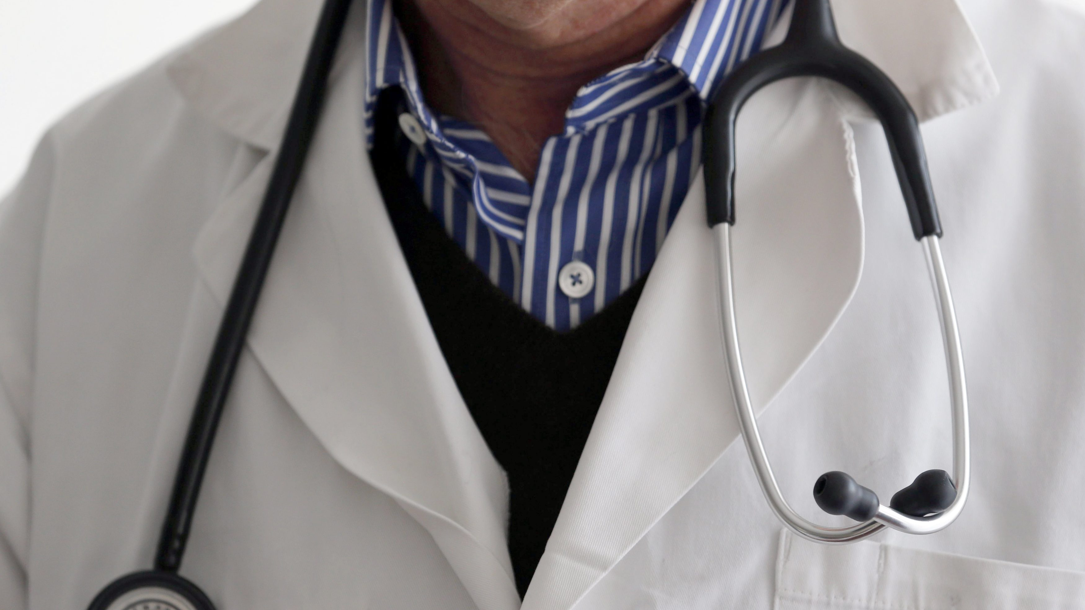 A photo illustration shows a French general practitioner with a stethoscope in a doctor's office in Bordeaux January 7, 2015. French physicians protest against a new health reform bill that would introduce a third party payment system. Picture taken January 7, 2015.   REUTERS/Regis Duvignau
