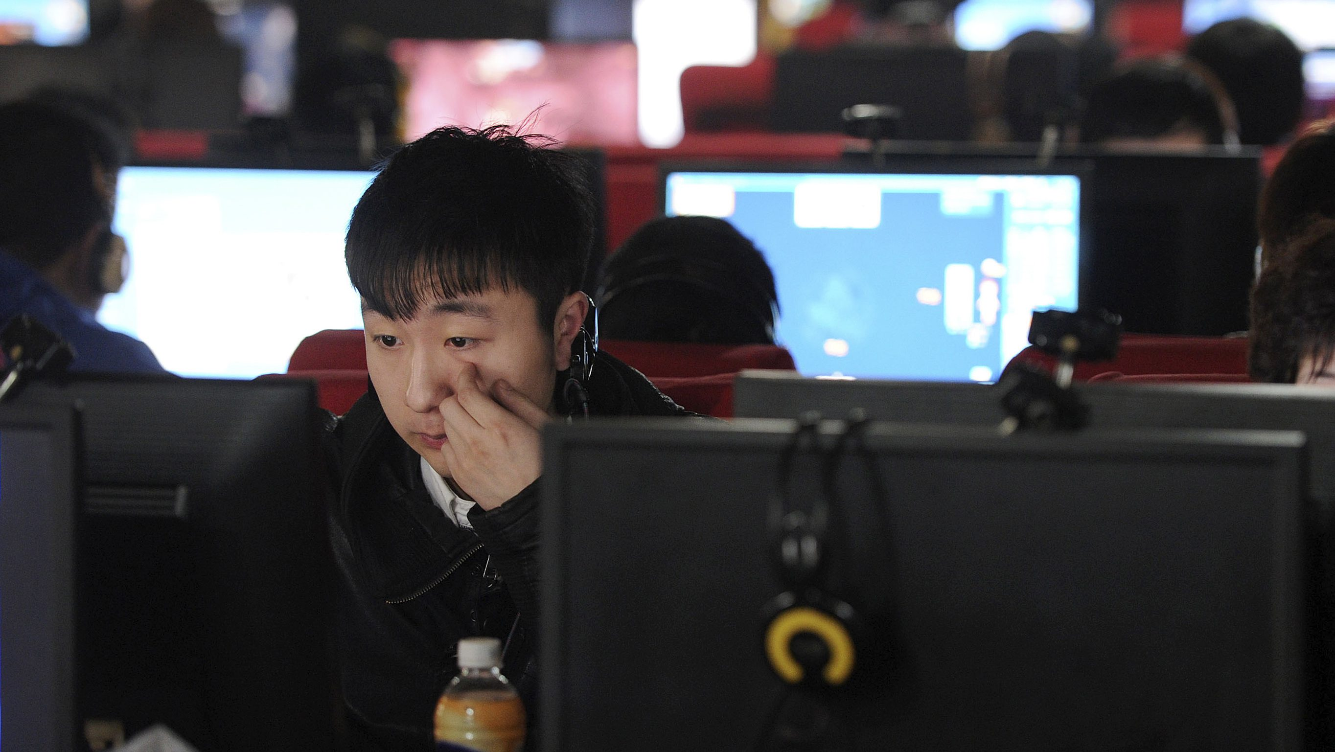 A man scratches his face as he uses a computer at an internet cafe in Hefei, Anhui province March 16, 2012. As of Friday, Beijing-based microbloggers were required to register on the Weibo platform using their real identities or face unspecified legal consequences, in a bid to curb what Communist officials call rumours, vulgarities and pornography. Many users, however, say the restrictions are clearly aimed at muzzling the often scathing, raucous - and perhaps most significantly, anonymous - online chatter in a country where the Internet offers a rare opportunity for open discussion. REUTERS/Stringer