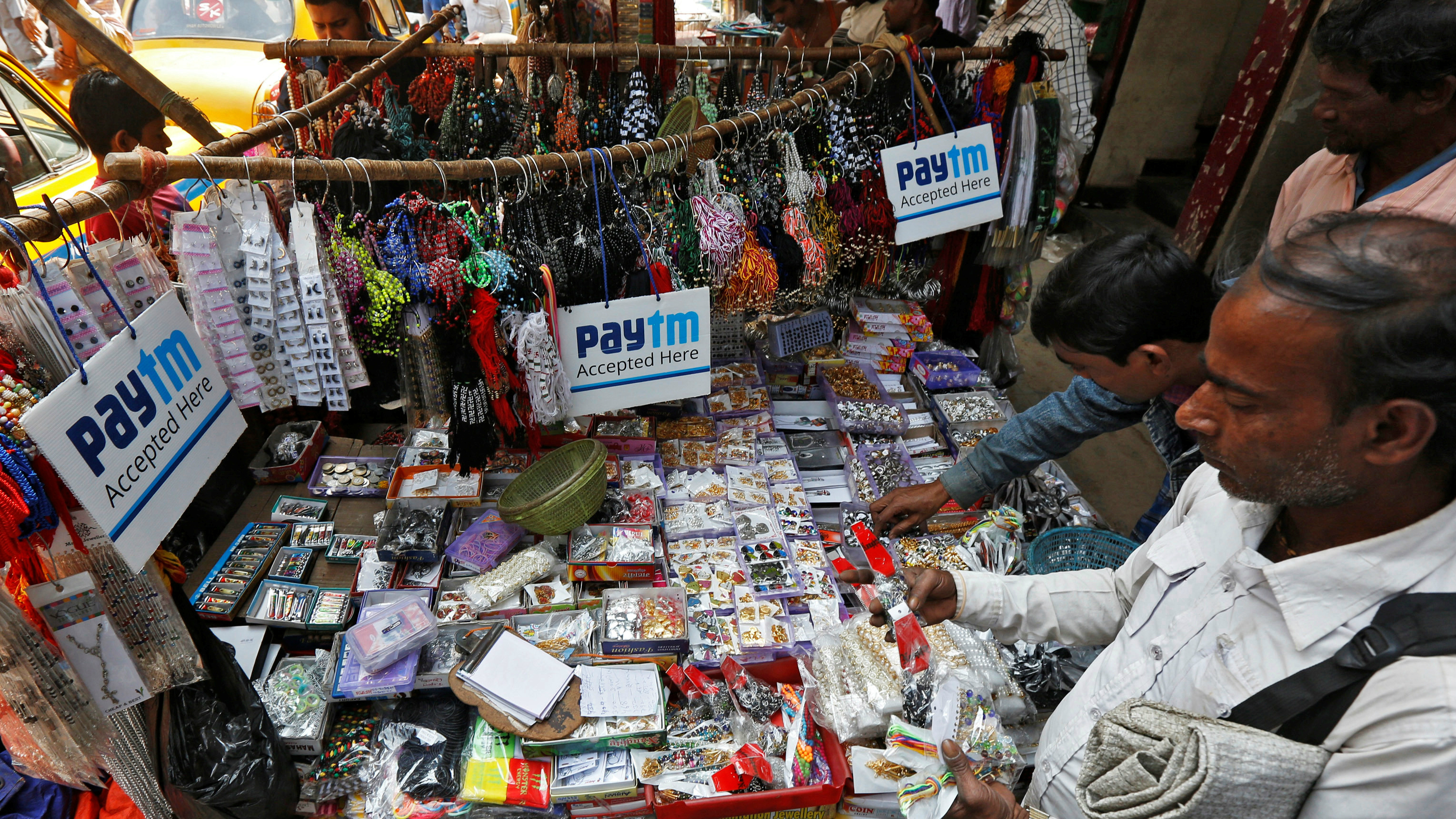 Advertisements of Paytm, a digital wallet company, are seen placed at a road side stall in Kolkata, India, January 25, 2017. Picture taken January 25, 2017. REUTERS/Rupak De Chowdhuri