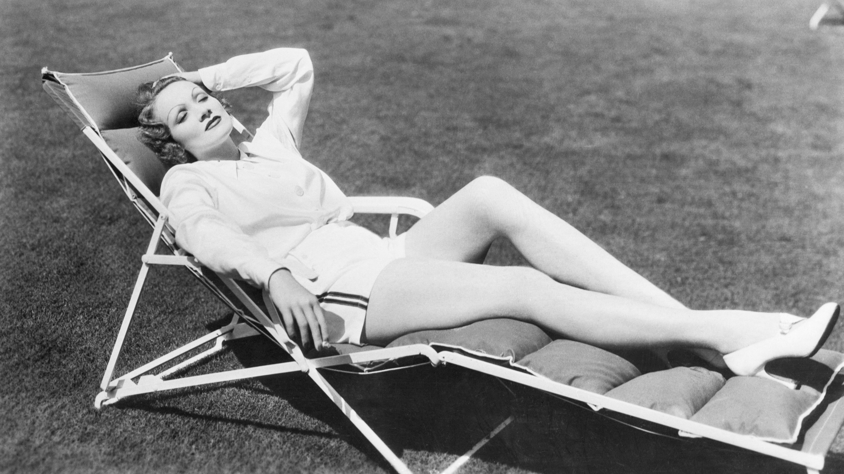 A woman lounging on a chair.