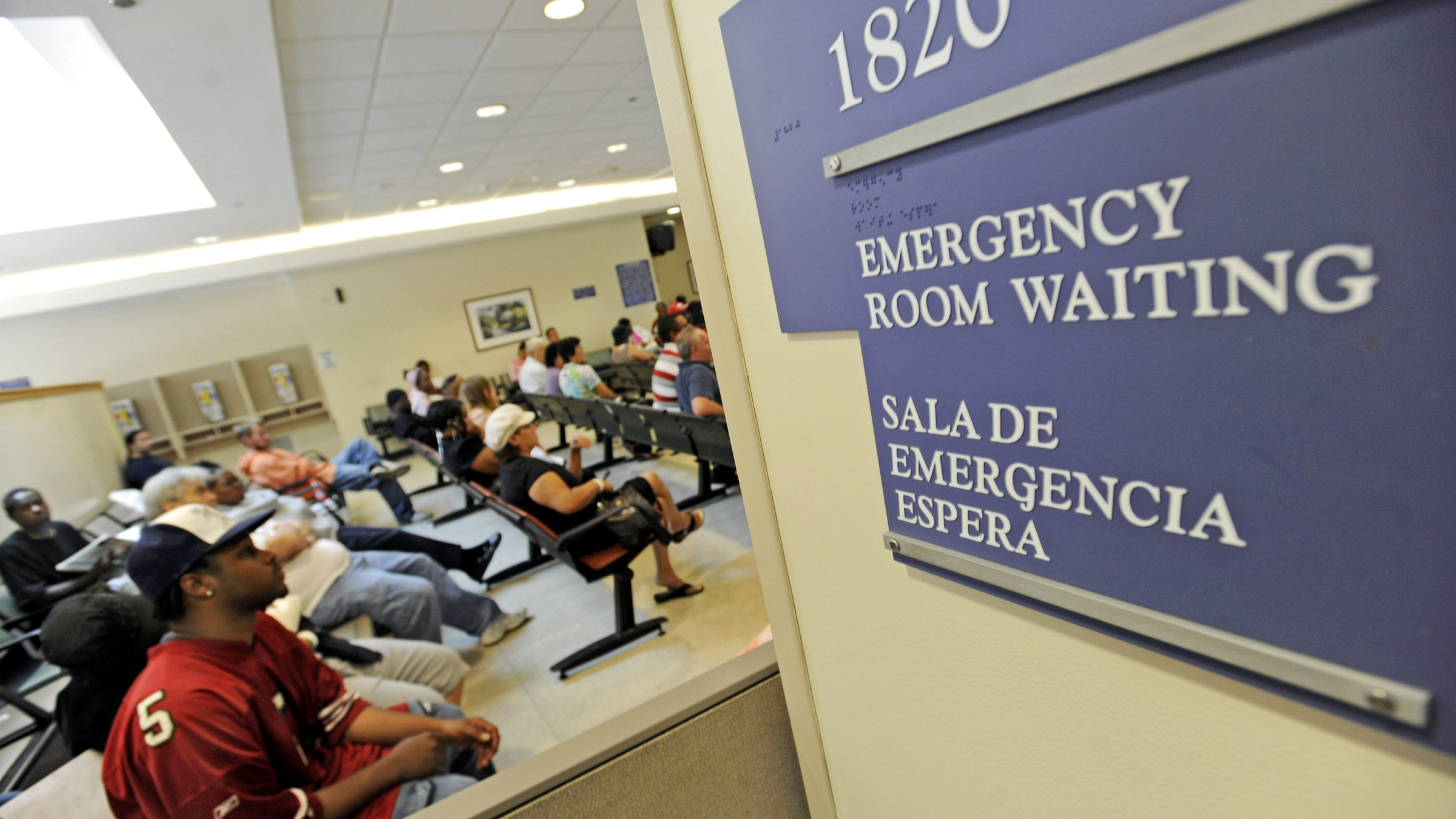 Patients waits in the emergency room waiting room at Cook County Hospital in Chicago.
