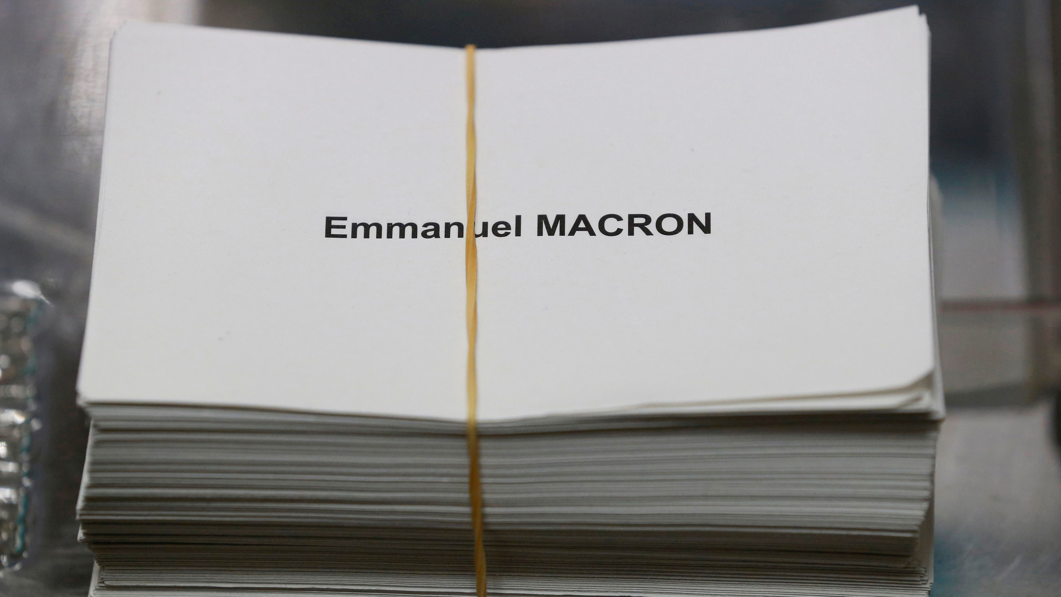 Ballots with the name of Emmanuel Macron, head of the political movement En Marche !, or Onwards !, and candidate for the 2017 presidential election, are seen on the eve of the second round of the French presidential election, at a polling station in Tulle, France, May 6, 2017. REUTERS/Regis Duvignau - RTS15EGC