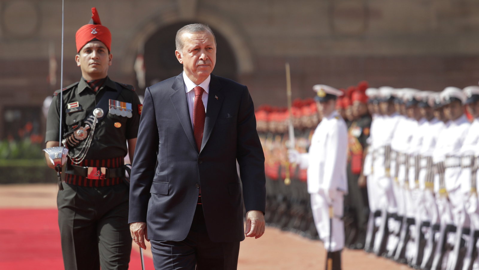 Turkish President Recep Tayyip Erdogan, second from left, inspects a military guard of honor upon his arrival at the Indian presidential palace in New Delhi, India, Monday, May 1, 2017. Erdogan is on a two-day state visit to India. (AP Photo/Manish Swarup)