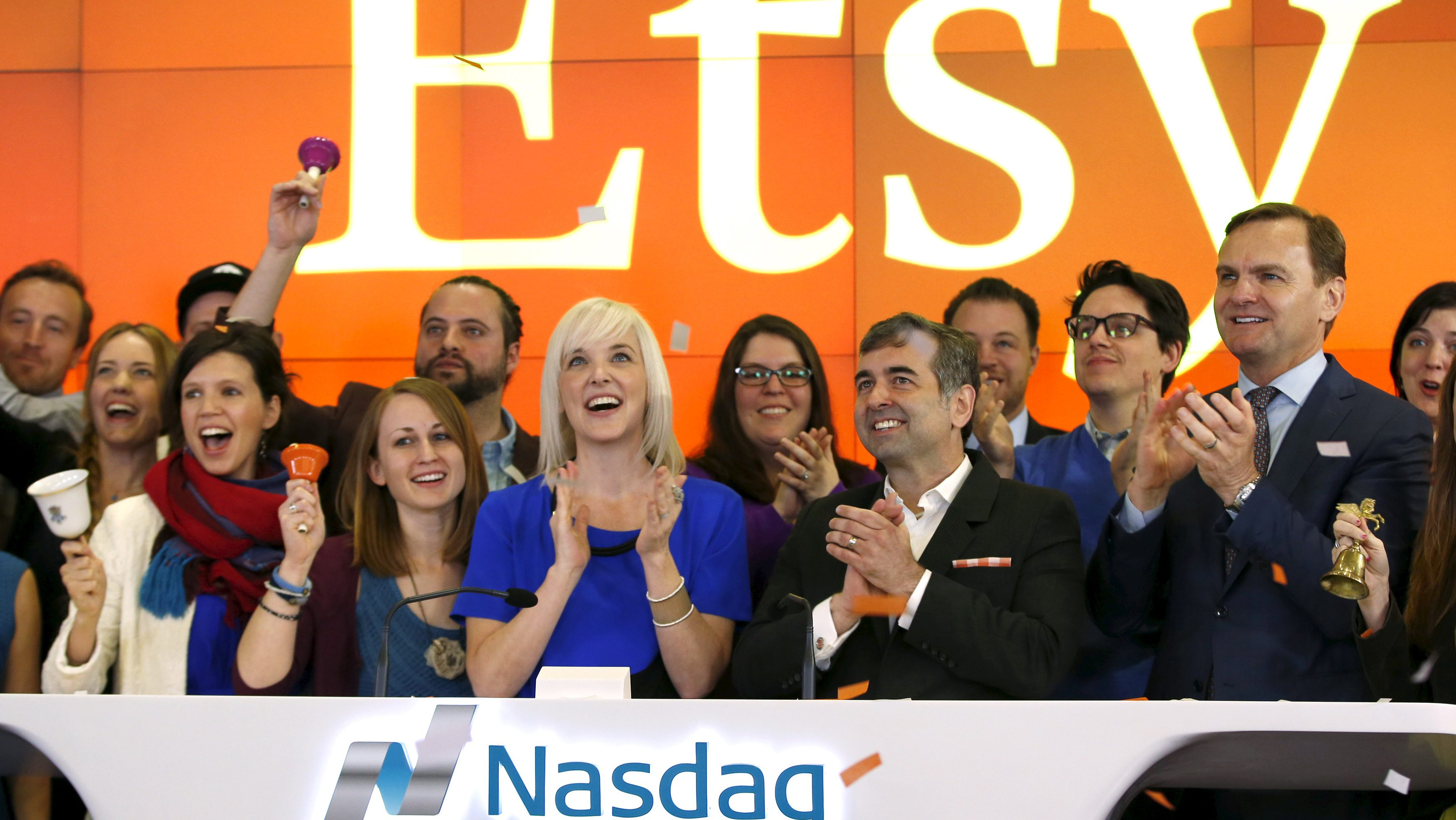 Etsy Inc's Chief Executive Officer Chad Dickerson (2nd from R) and Chief Financial Officer Kristina Salen (C) stand with Etsy Employees and Nasdaq Executive Vice President Bruce Aust (R) as they celebrate Etsy's initial public offering (IPO) at the Nasdaq market site in New York April 16, 2015. Etsy's initial public offering has been priced at $16 per share, a market source told Reuters, valuing the online seller of handmade goods and craft supplies at about $1.78 billion.
