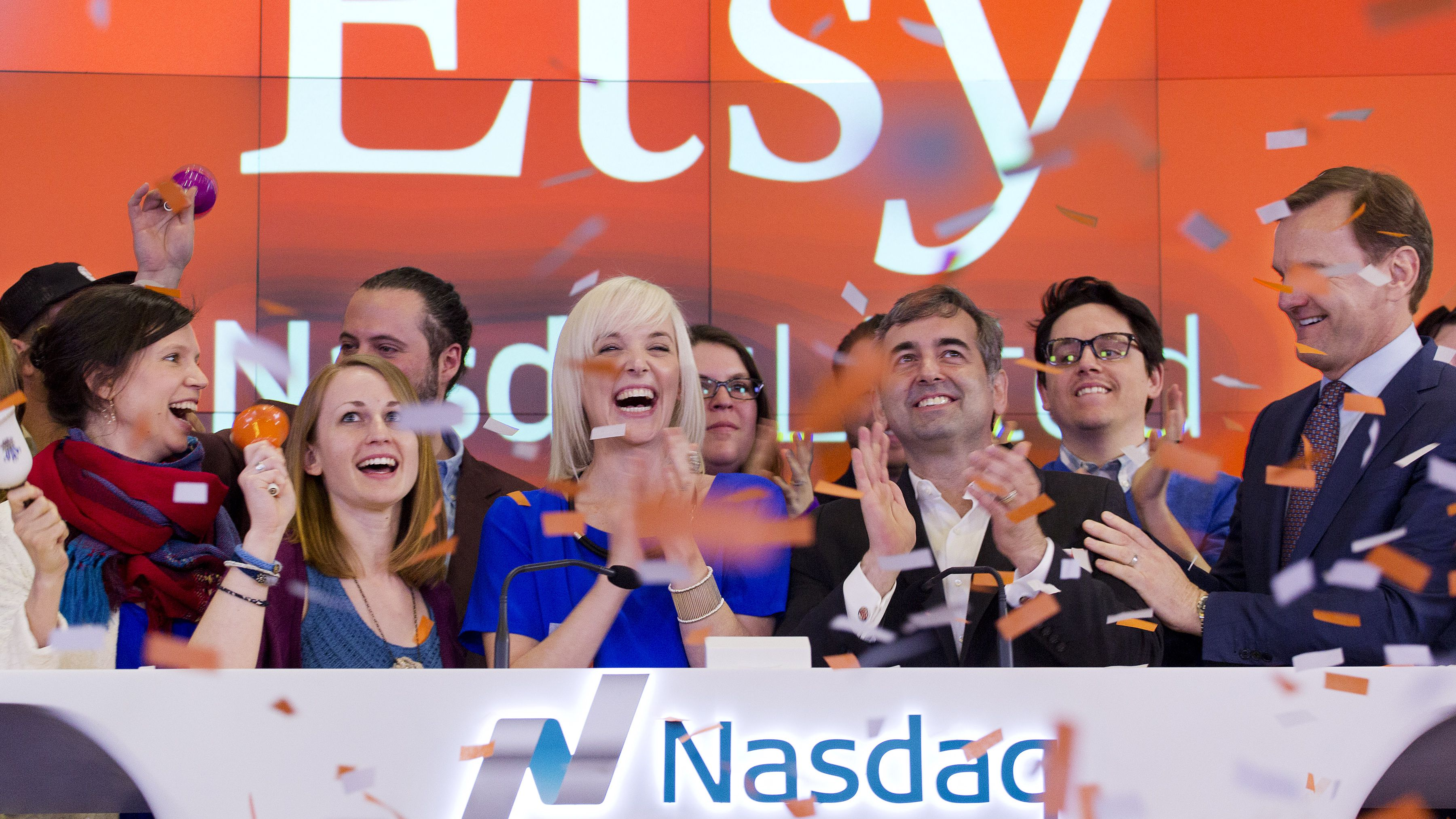 Etsy Inc's Chief Executive Officer Chad Dickerson (2nd from R) and Chief Financial Officer Kristina Salen (C) stand with Etsy Employees and Nasdaq Executive Vice President Bruce Aust (R) as they celebrate Etsy's initial public offering (IPO) at the Nasdaq market site in New York April 16, 2015. Etsy's initial public offering has been priced at $16 per share, a market source told Reuters, valuing the online seller of handmade goods and craft supplies at about $1.78 billion. REUTERS/Mike Segar