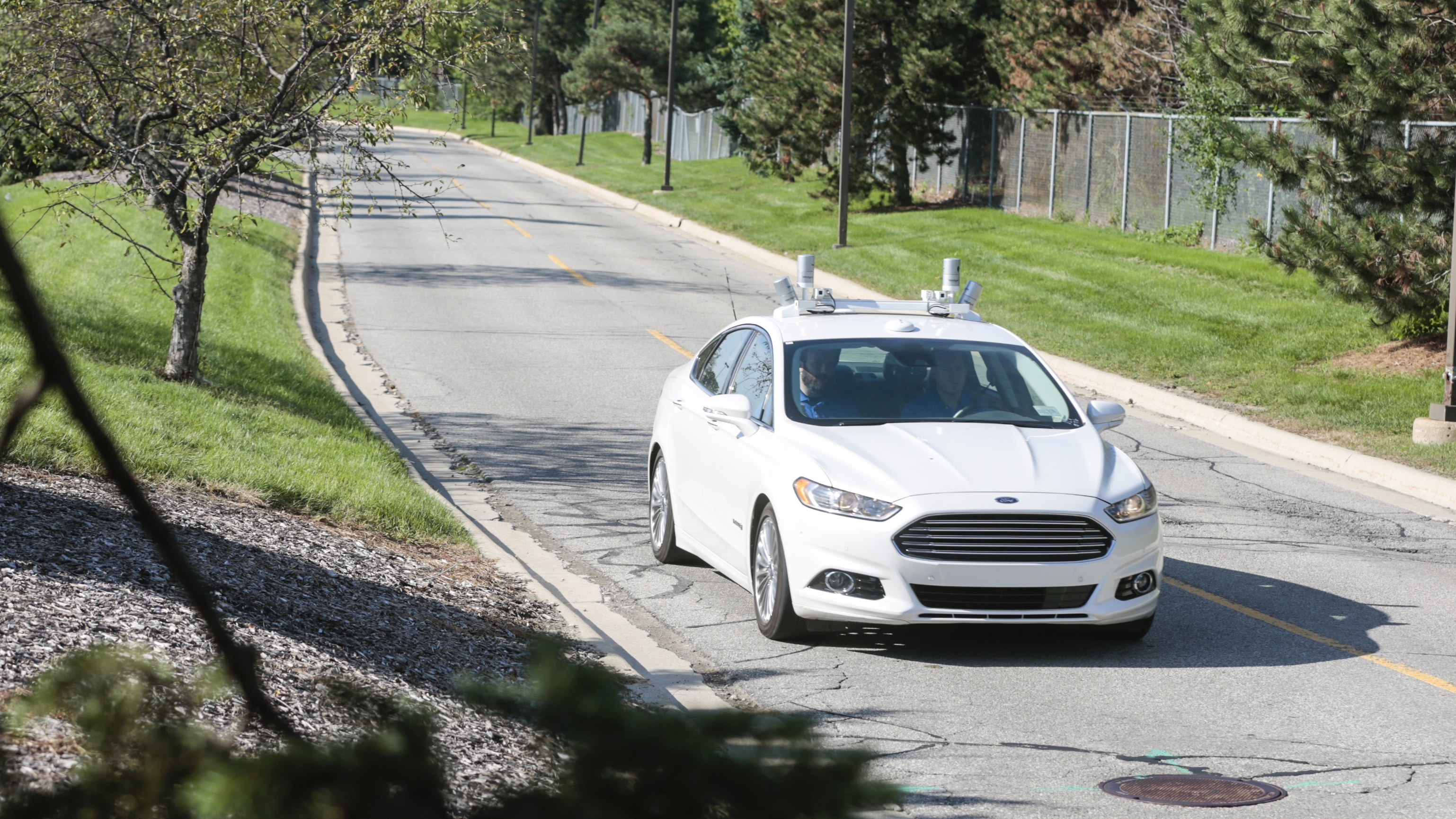 Ford's fully autonomous Fusion Hybrid research vehicle on the streets of Dearborn, Mich. Ford has been researching autonomous vehicles for more than a decade and currently tests fully autonomous vehicles in Michigan, Arizona and California. Ford recently announced its intent to have a high-volume, fully autonomous SAE level 4-capable vehicle in commercial operation in 2021 in a ride-hailing or ride-sharing service.