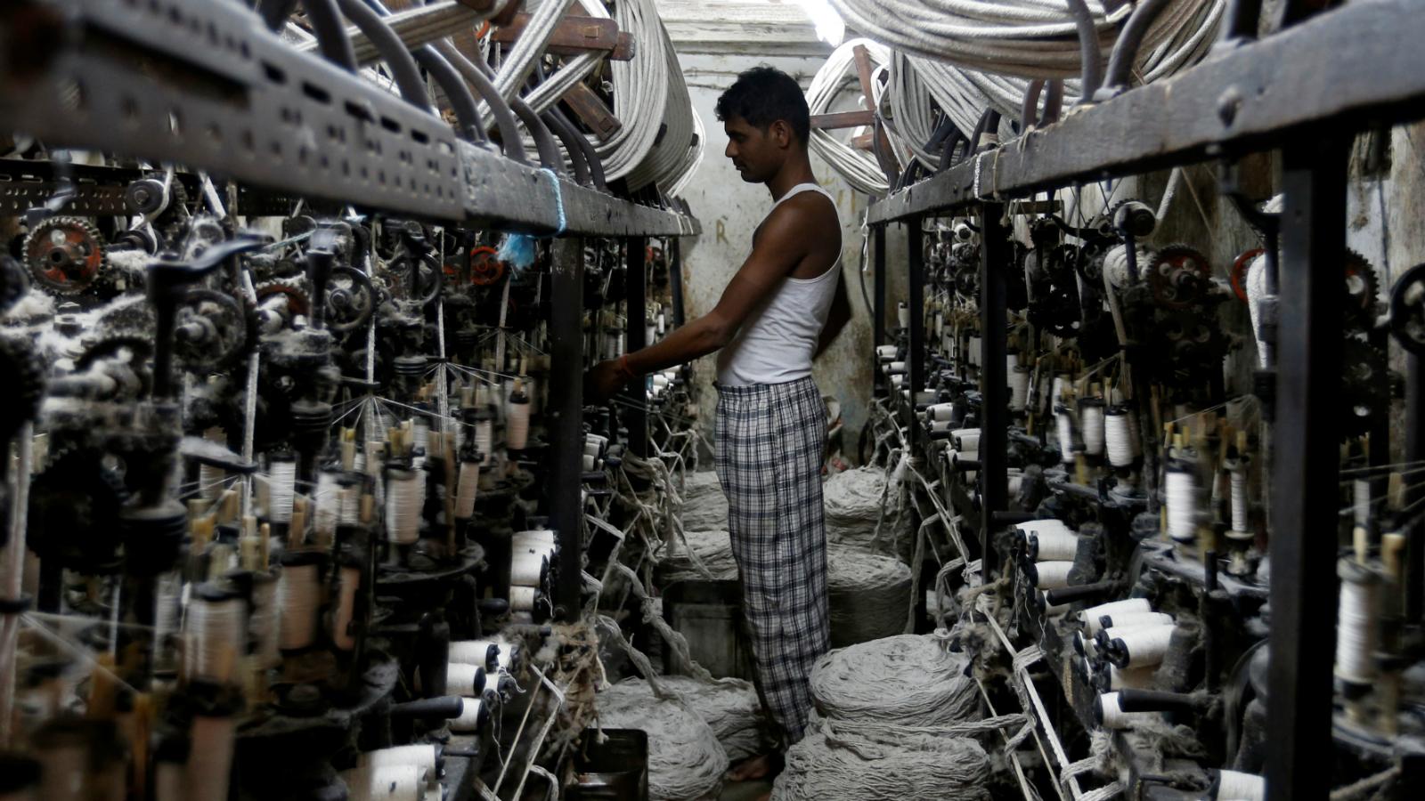An employee works inside a garment factory in Mumbai, India February 28, 2017.
