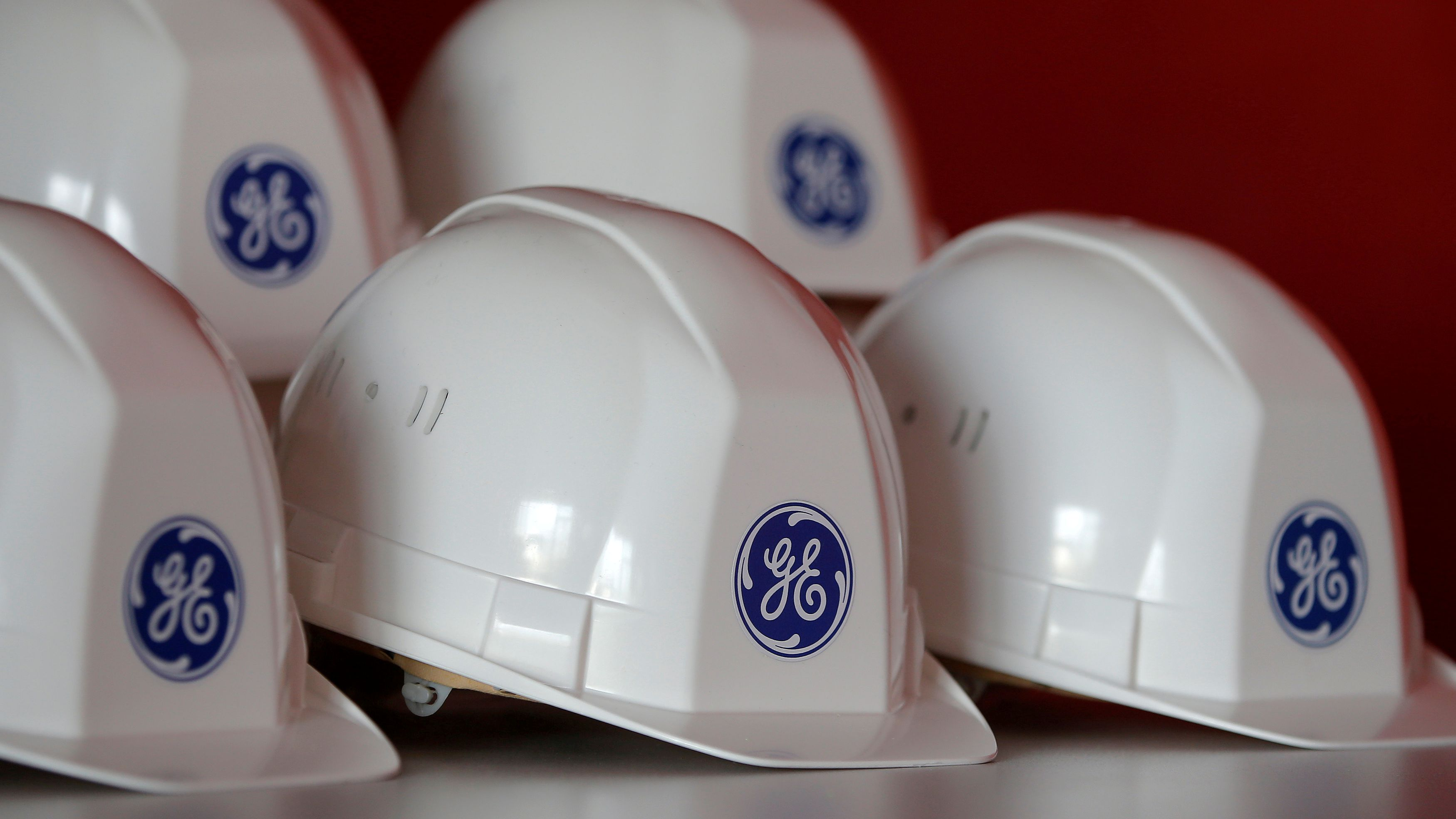 FILE PHOTO: The General Electric logo is pictured on working helmets during a visit at the General Electric offshore wind turbine plant in Montoir-de-Bretagne, near Saint-Nazaire, western France, November 21, 2016. REUTERS/Stephane Mahe/File Photo GLOBAL BUSINESS WEEK AHEAD - SEARCH GLOBAL BUSINESS 17 APR FOR ALL IMAGES