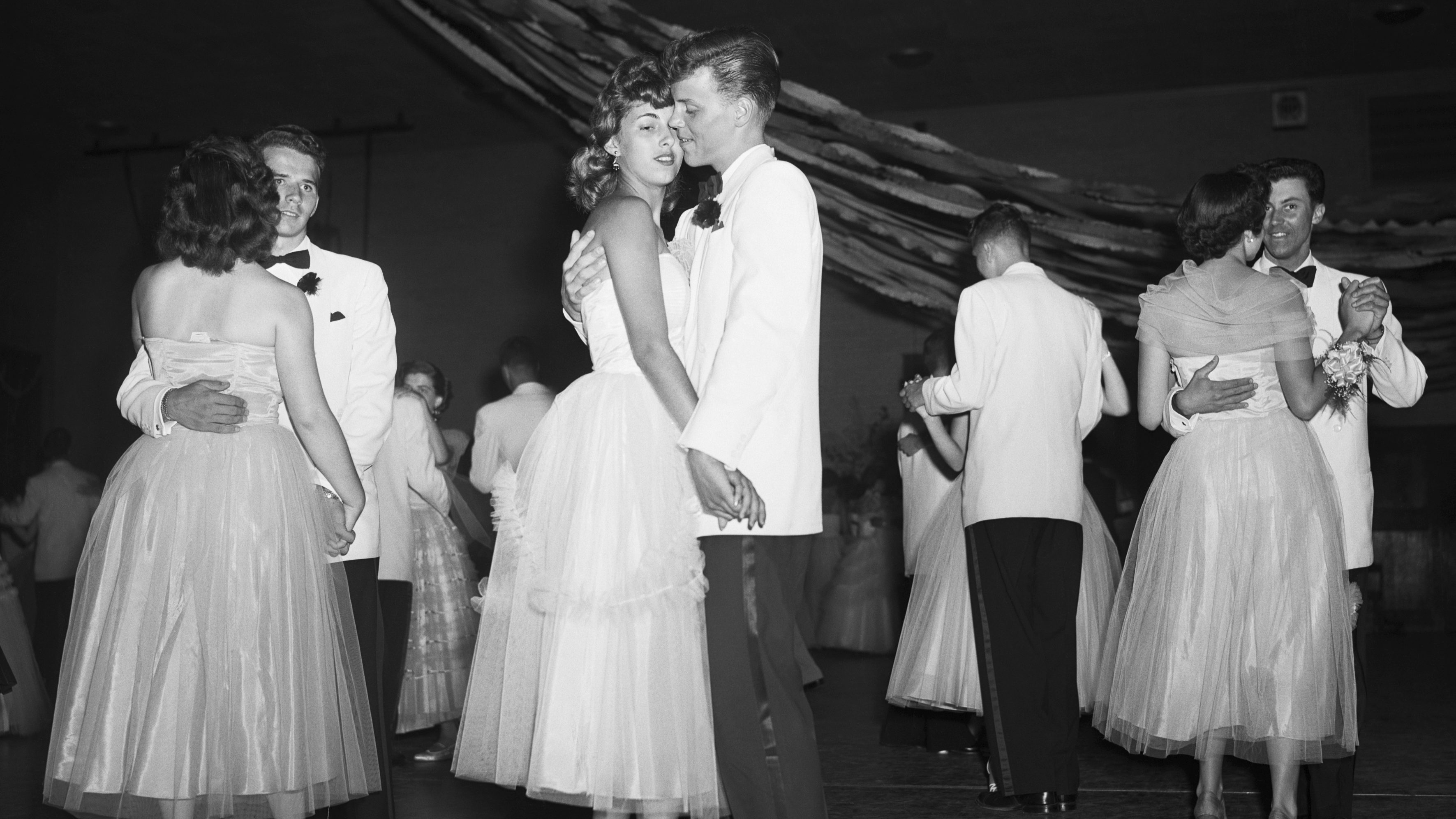 David Brandt and Ruth Estelle dance at the Senior Prom at Anacosta High School. Their double date, Barbara Belchak and Dan Knode, also dance, left. | Location: Anacosta, Maryland, USA.