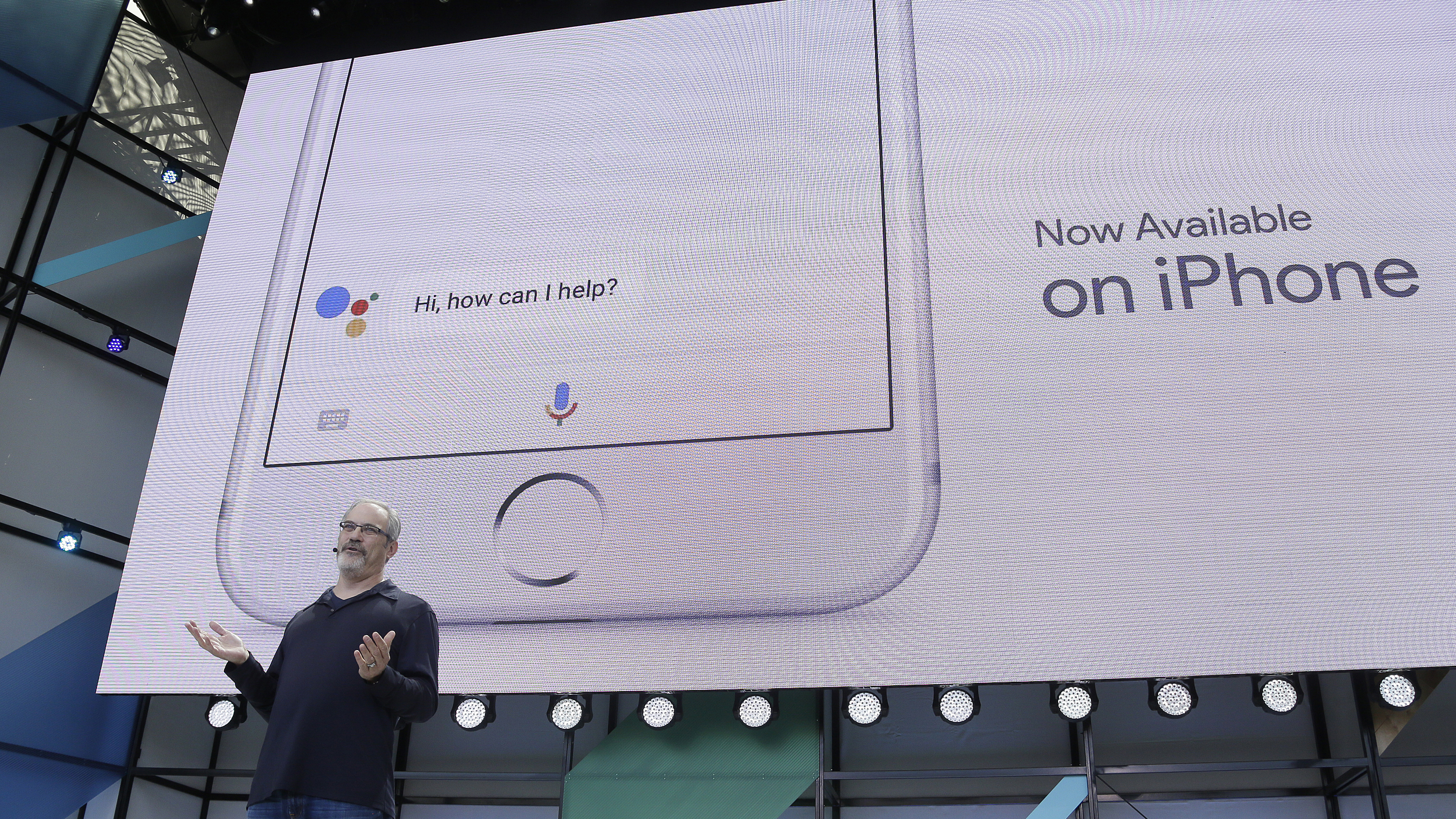Scott Huffman talks about the Google Assistant now being available on the Apple iPhone during the keynote address of the Google I/O conference, Wednesday, May 17, 2017, in Mountain View, Calif. (AP Photo/Eric Risberg)