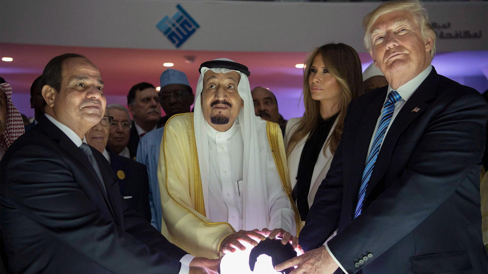 A handout photo made available by the Saudi Press Agency (SPA) shows US President Donald J. Trump (R), US First Lady Melania Trump (R-2), King Salman bin Abdulaziz al-Saud of Saudi Arabia (C) and Egyptian President Abdel Fattah al-Sisi (L) opening the World Center for Countering Extremist Thought in Riyadh, Saudi Arabia, 21 May 2017. President Trump is in Ridayah to attend the Gulf Cooperation Council summit (GCC).