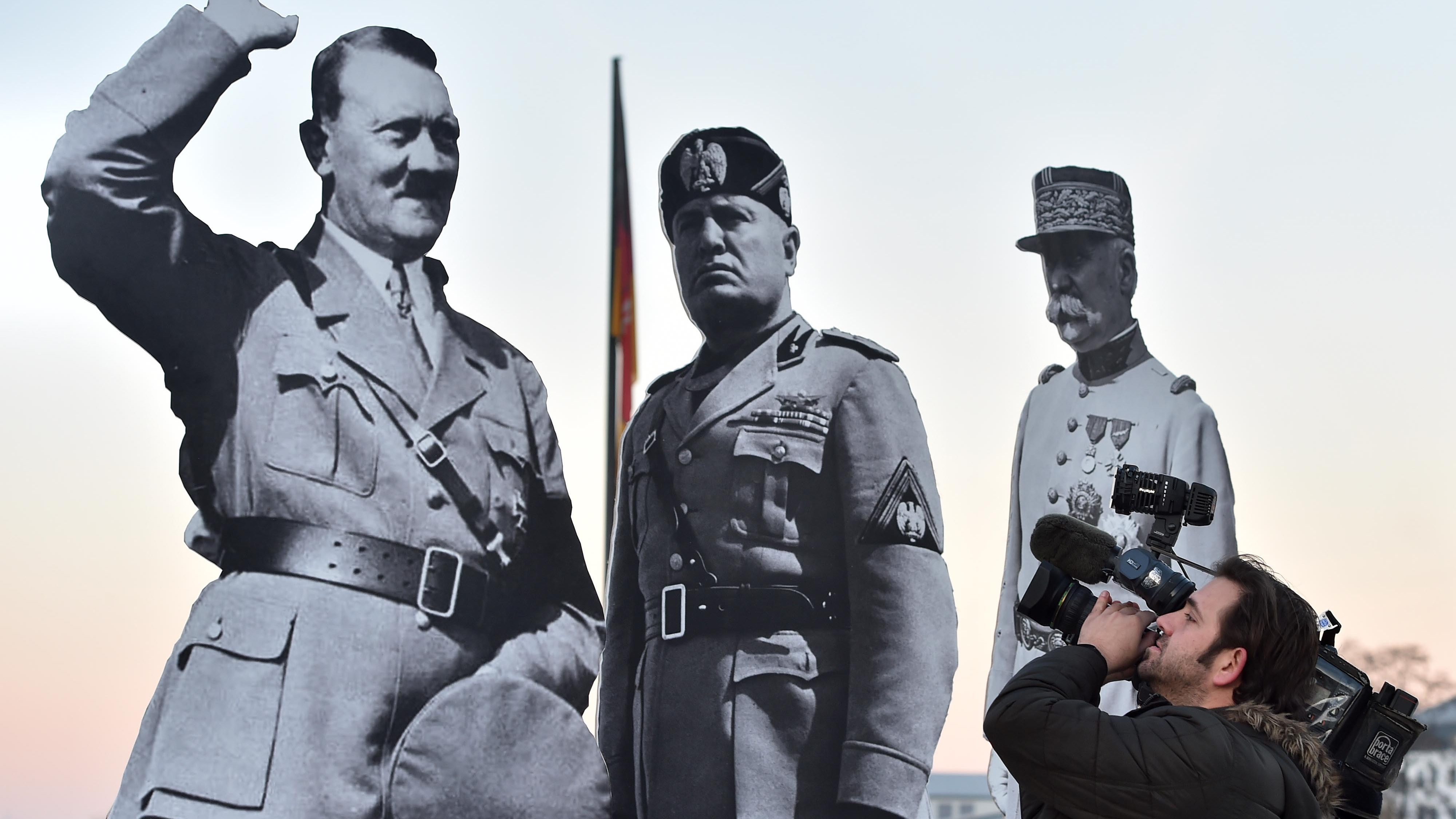 IMAGE DISTRIBUTED FOR AVAAZ -  Giant images of Hitler, Stalin, Mussolini, Franco and Petain in front of the historic Deutsches Eck statue in Koblenz, Germany, installed by the global civic movement Avaaz to warn of the return of fascism to Europe, as far right politicians gather in Koblenz on Saturday, 21 January 2017. (Torsten Silz/AP Images for AVAAZ)
