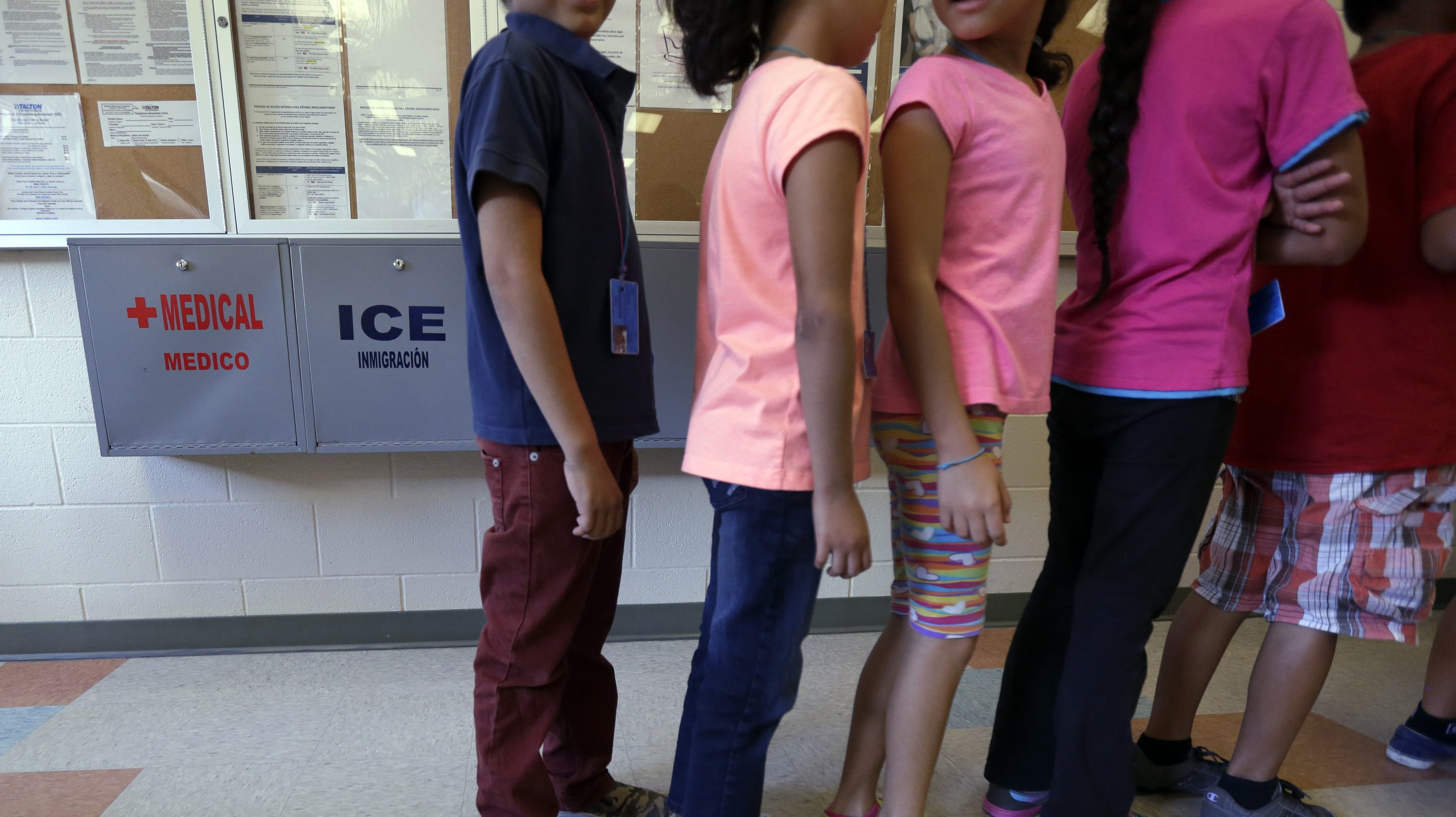 detained immigrant children line up at a detention center