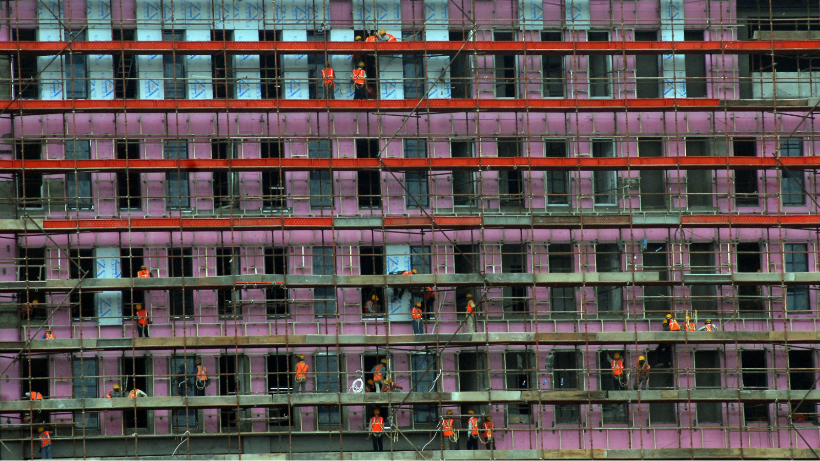 Labourers work at the construction site of a commercial estate in the southern Indian city of Chennai February 1, 2011. Infrastructure data is considered an advance indicator of growth in industrial output, which has been volatile in recent months, although the dominant concern for India's central bank is tackling headline inflation, caused partly by the knock-on effects of high food prices.