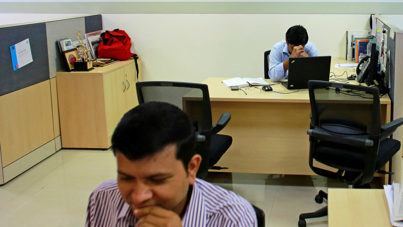 Employees of Tata Consultancy Services (TCS) work inside the company headquarters in Mumbai March 14, 2013. REUTERS/Danish Siddiqui/File Photo