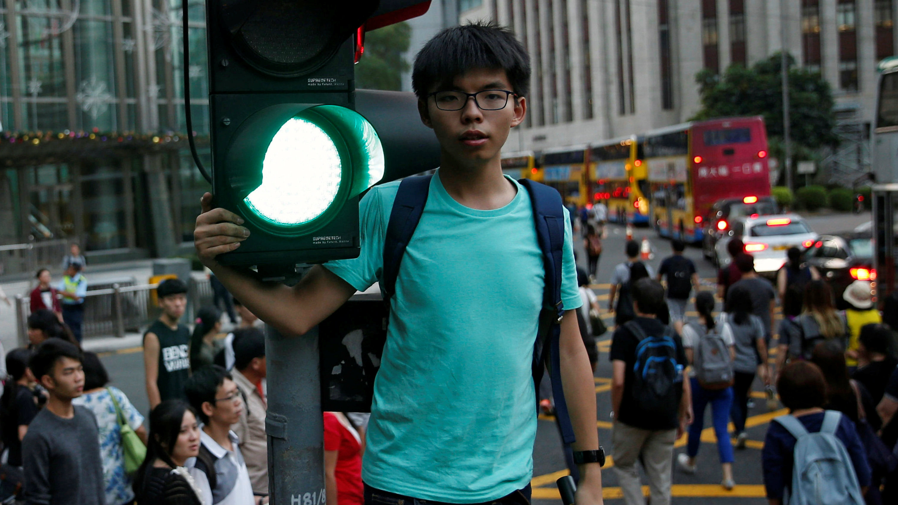 Pro-democracy activist Joshua Wong shouts during a protest in Hong Kong, China November 6, 2016. Picture taken November 6, 2016. REUTERS/Tyrone Siu