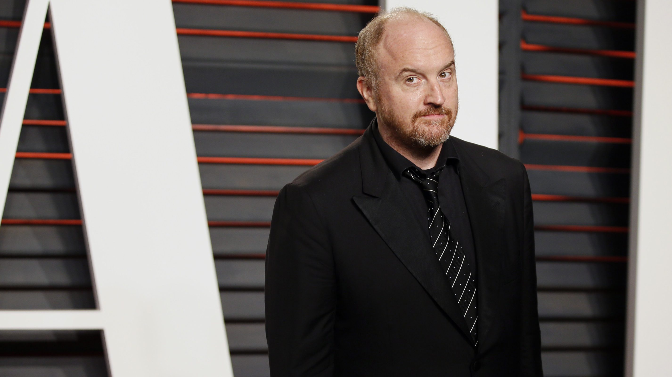 Comedian Louis C.K. arrives at the Vanity Fair Oscar Party