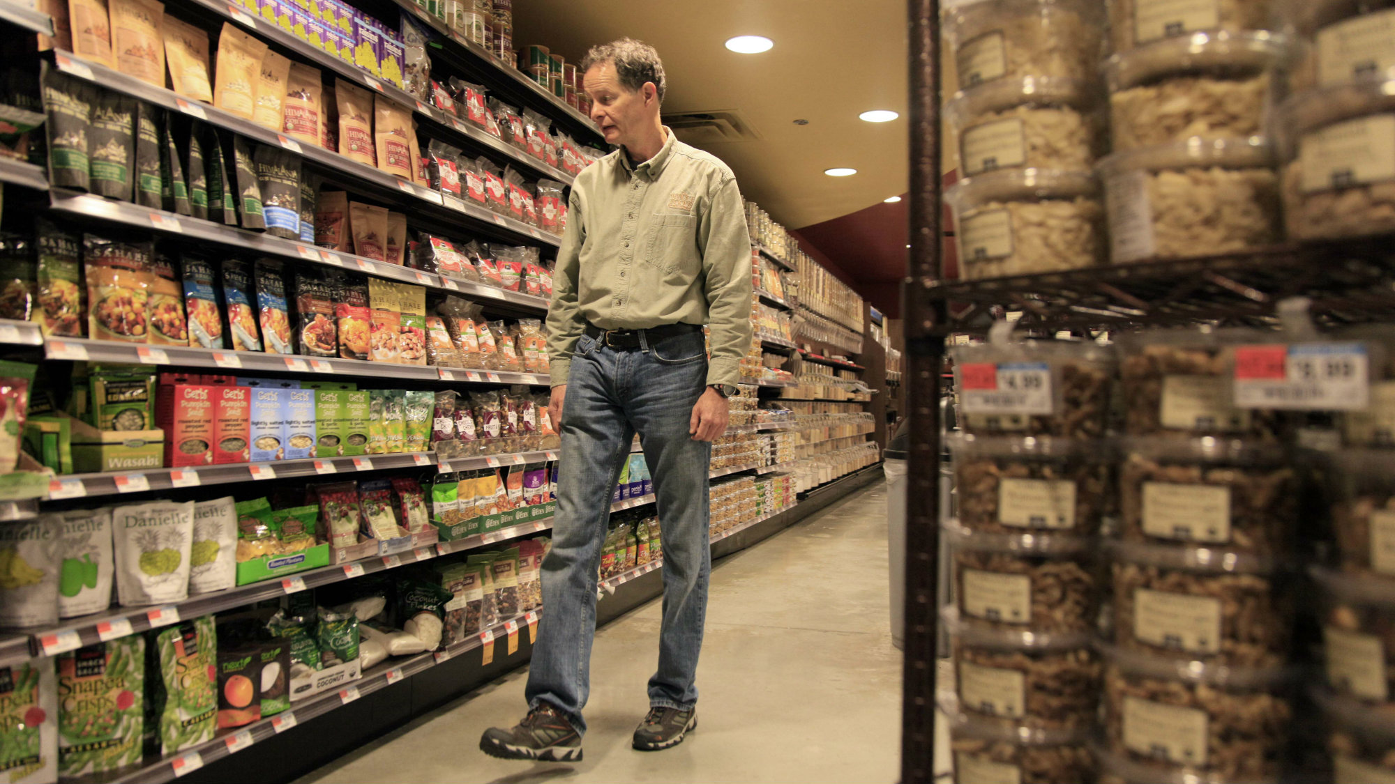 Whole Foods CEO John Mackey is photographed walking through one of his stores on New York's Upper West Side, Wednesday, Nov. 18, 2009.