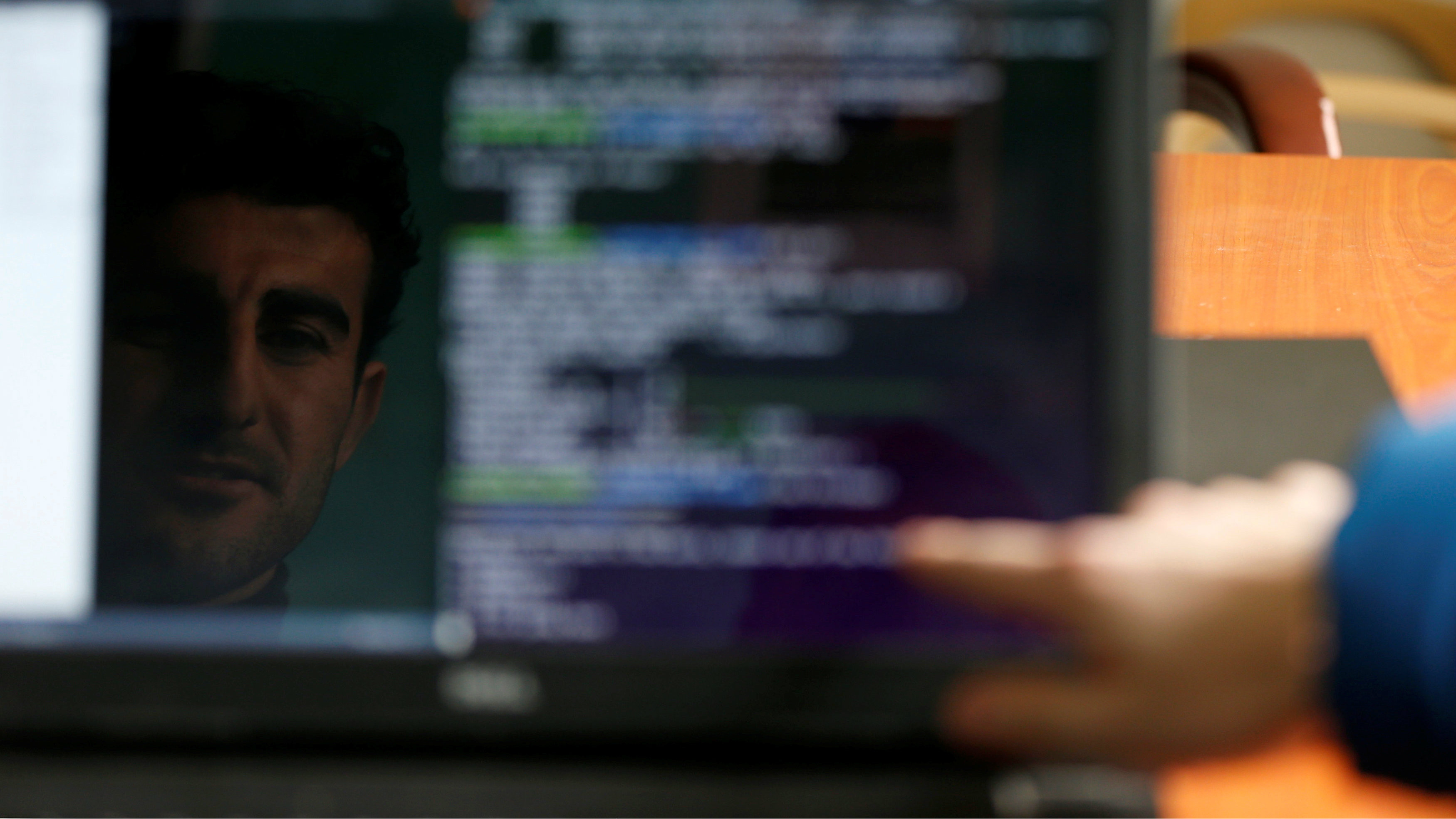 One of the Syrian refugees and displaced Iraqis students is reflected in the computer screen as he attends a class to learn basic and advanced coding skills at Re:Coded boot camp, in Erbil, Iraq February 1, 2017. Picture taken February 1, 2017. REUTERS/Muhammad Hamed