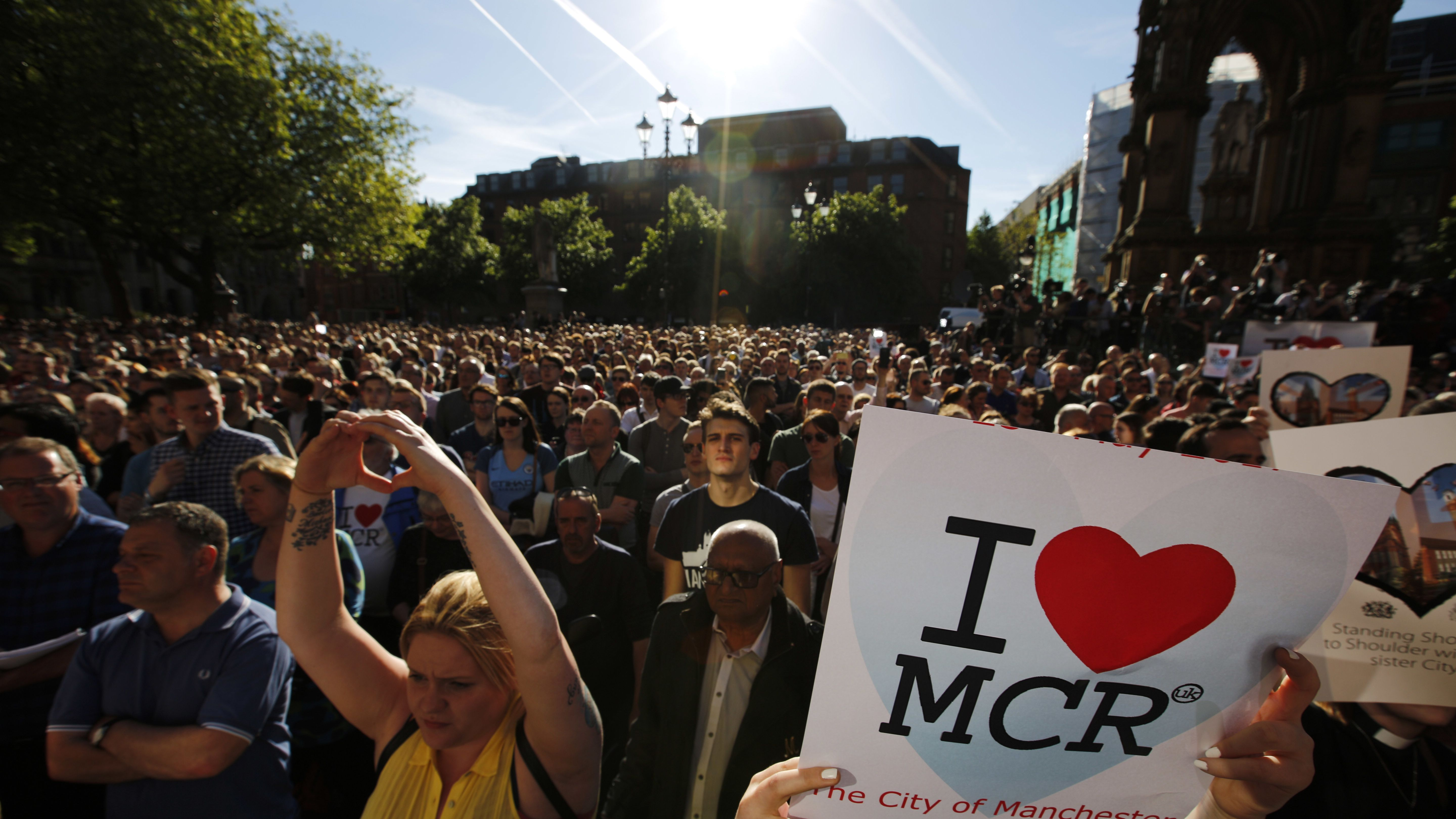 Crowds gather for a vigil in Albert Square, Manchester, England, Tuesday May 23, 2017, the day after the suicide attack at an Ariana Grande concert that left 22 people dead as it ended on Monday night.  (AP Photo/Emilio Morenatti)