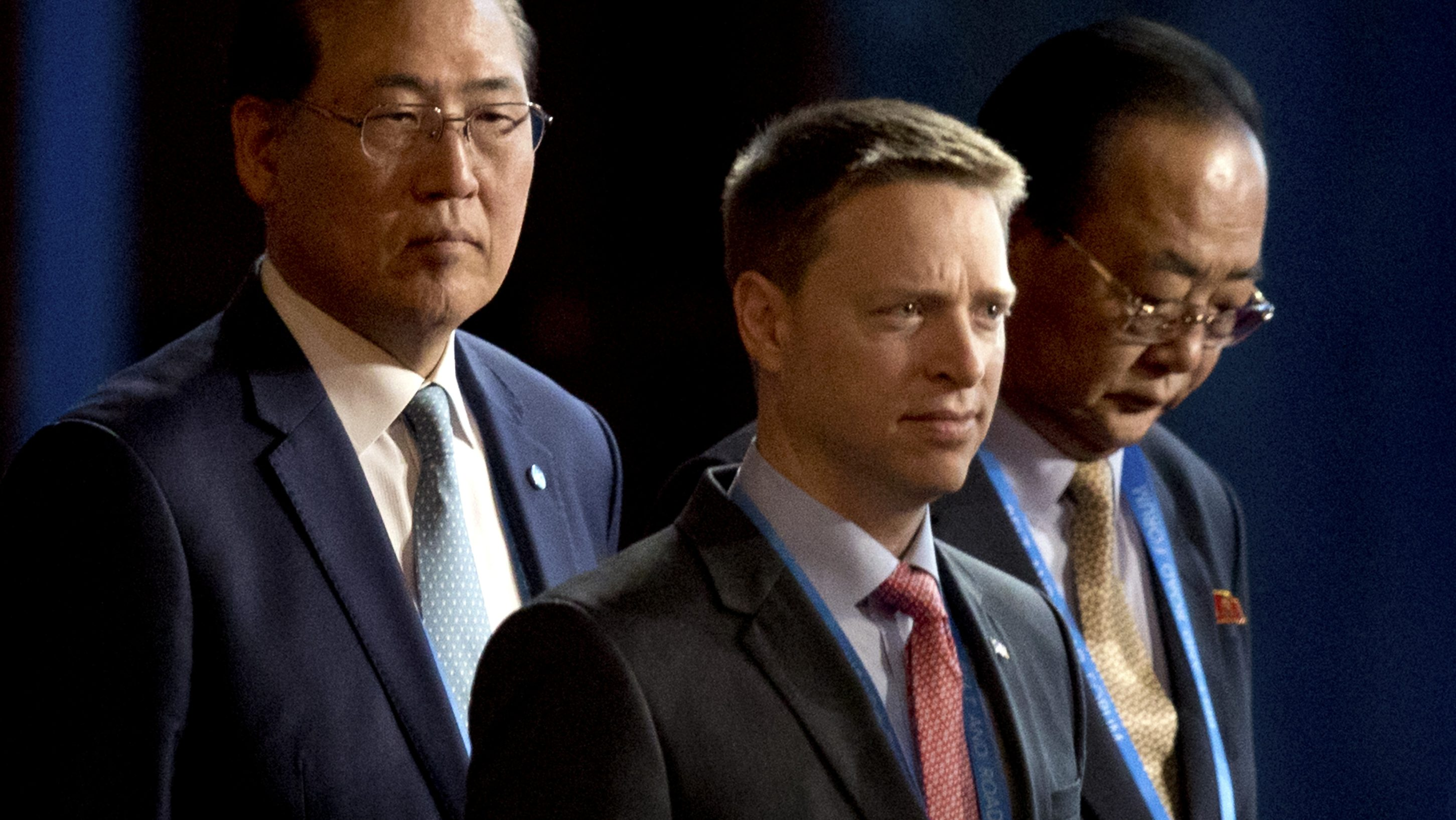 Matt Pottinger (C), Special Assistant to U.S. President Donald Trump and National Security Council (NSC) Senior Director for East Asia, and Kim Yong Jae (R), North KoreaÕs minister of external economic relations, arrive for the opening ceremony of the Belt and Road Forum at the China National Convention Center (CNCC) in Beijing, Sunday, May 14, 2017. AP Photo/Mark Schiefelbein