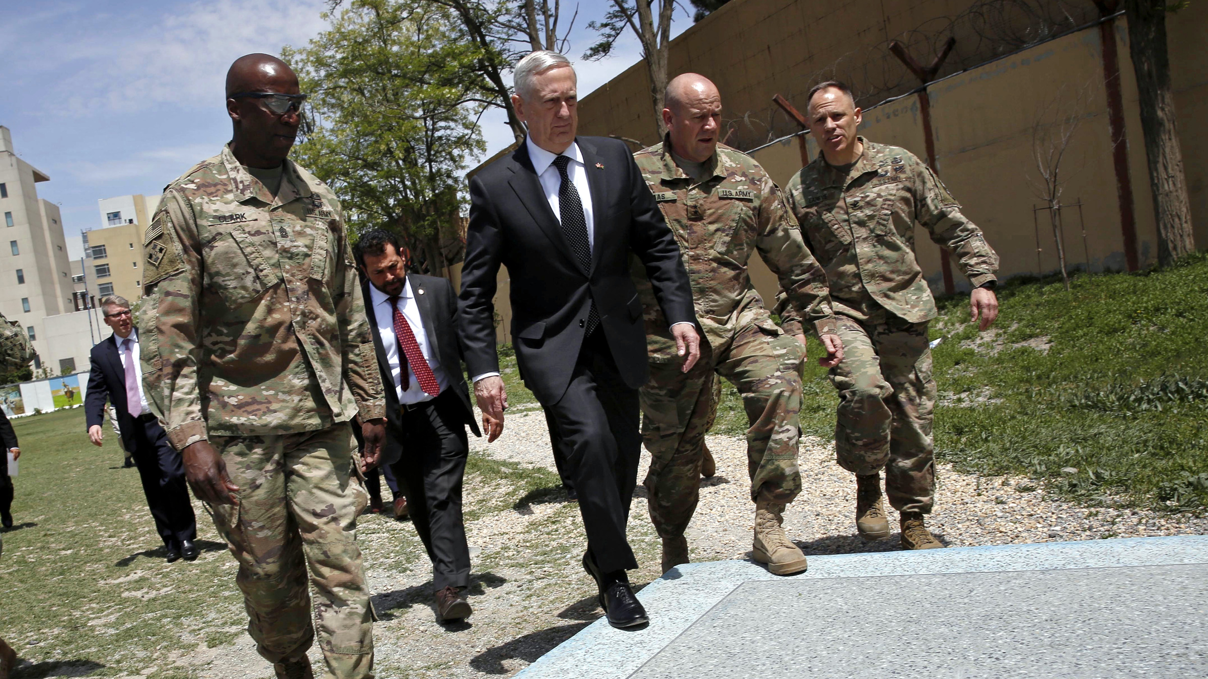 /// U.S. Defense Secretary James Mattis (3rd R) is greeted by U.S. Army Command Sergeant Major David Clark (L) and General Christopher Haas (2nd R) as he arrives at Resolute Support headquarters in Kabul, Afghanistan April 24, 2017.