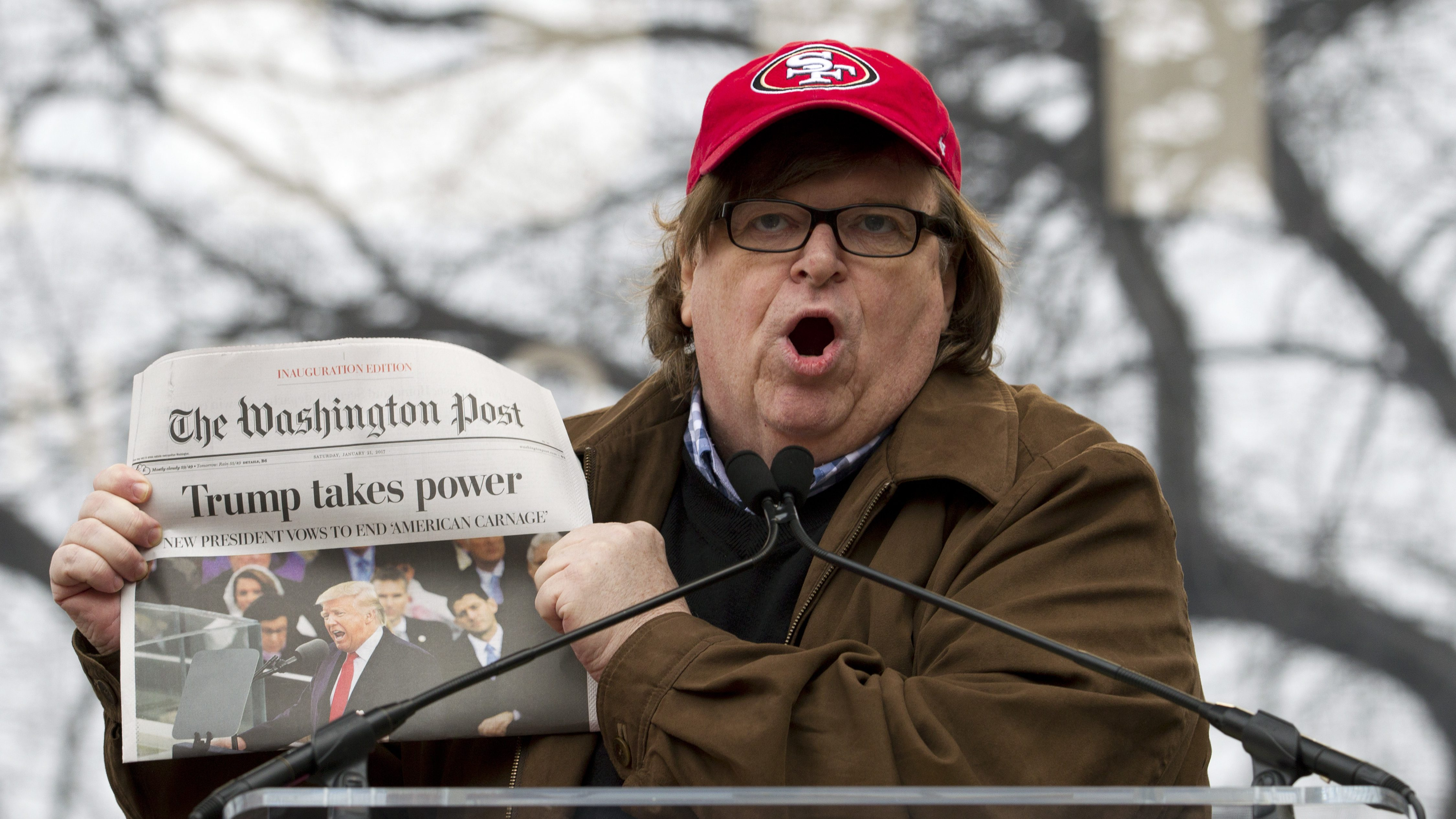 Film director Michael Moore speaks to the crowd during the Women's March rally, Saturday, Jan. 21, 2017 in Washington. In a global exclamation of defiance and solidarity, more than 1 million people rallied at women's marches in the nation's capital and cities around the world Saturday to send President Donald Trump an emphatic message on his first full day in office that they won't let his agenda go unchallenged. ( AP Photo/Jose Luis Magana)
