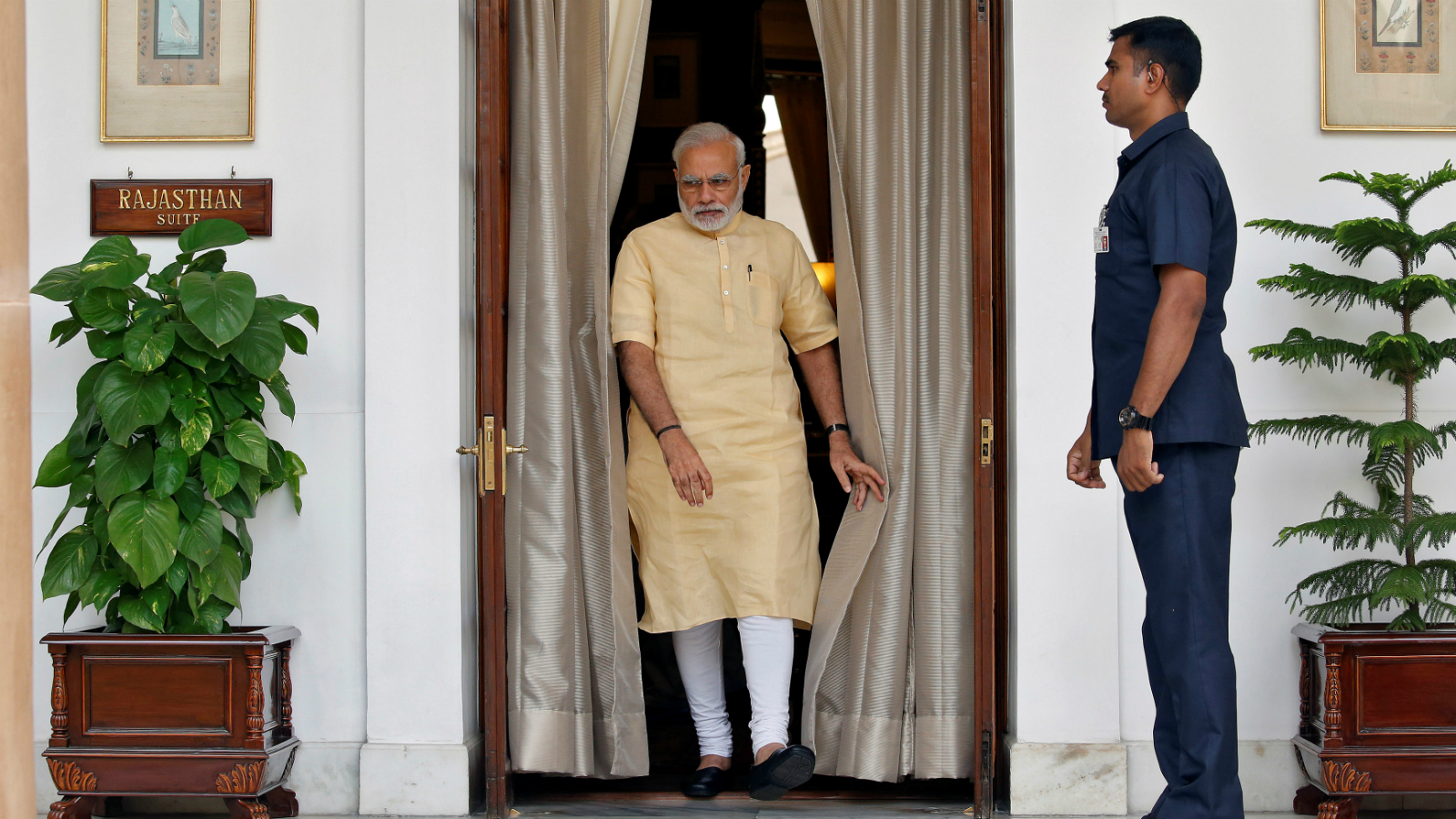India's Prime Minister Narendra Modi makes his way to greet Afghan President Ashraf Ghani (not pictured) inside Hyderabad House in Delhi, India September 14, 2016.
