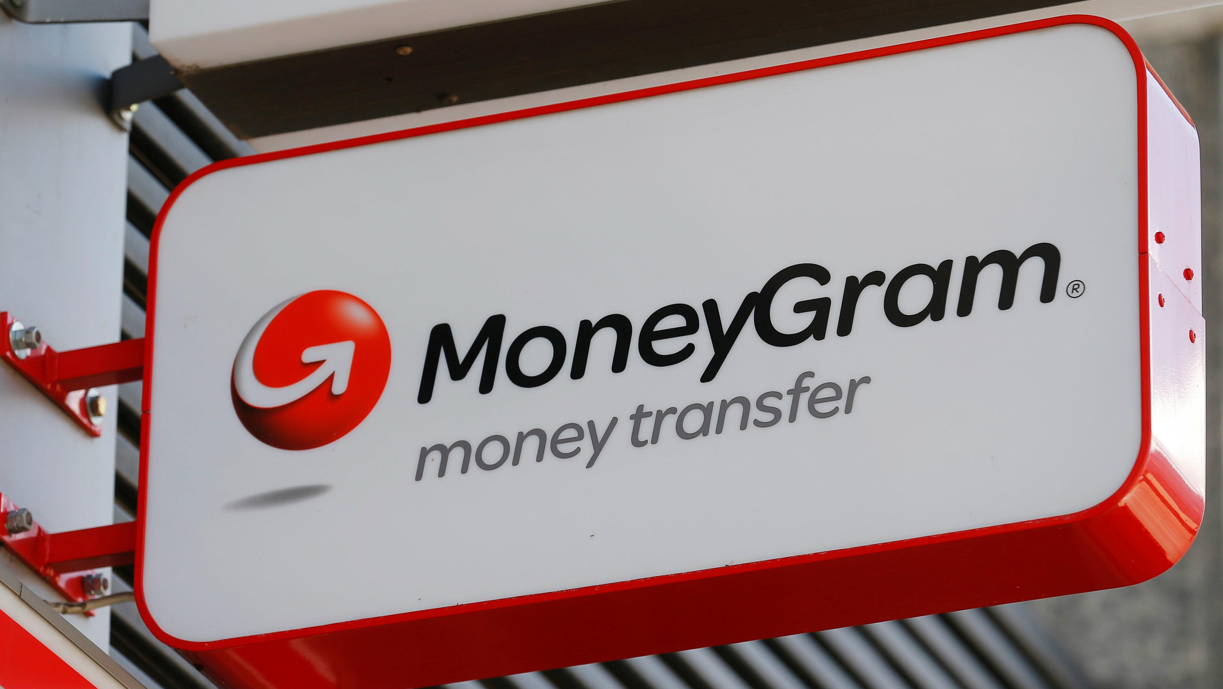 A Moneygram logo is seen outside a bank in Vienna, Austria