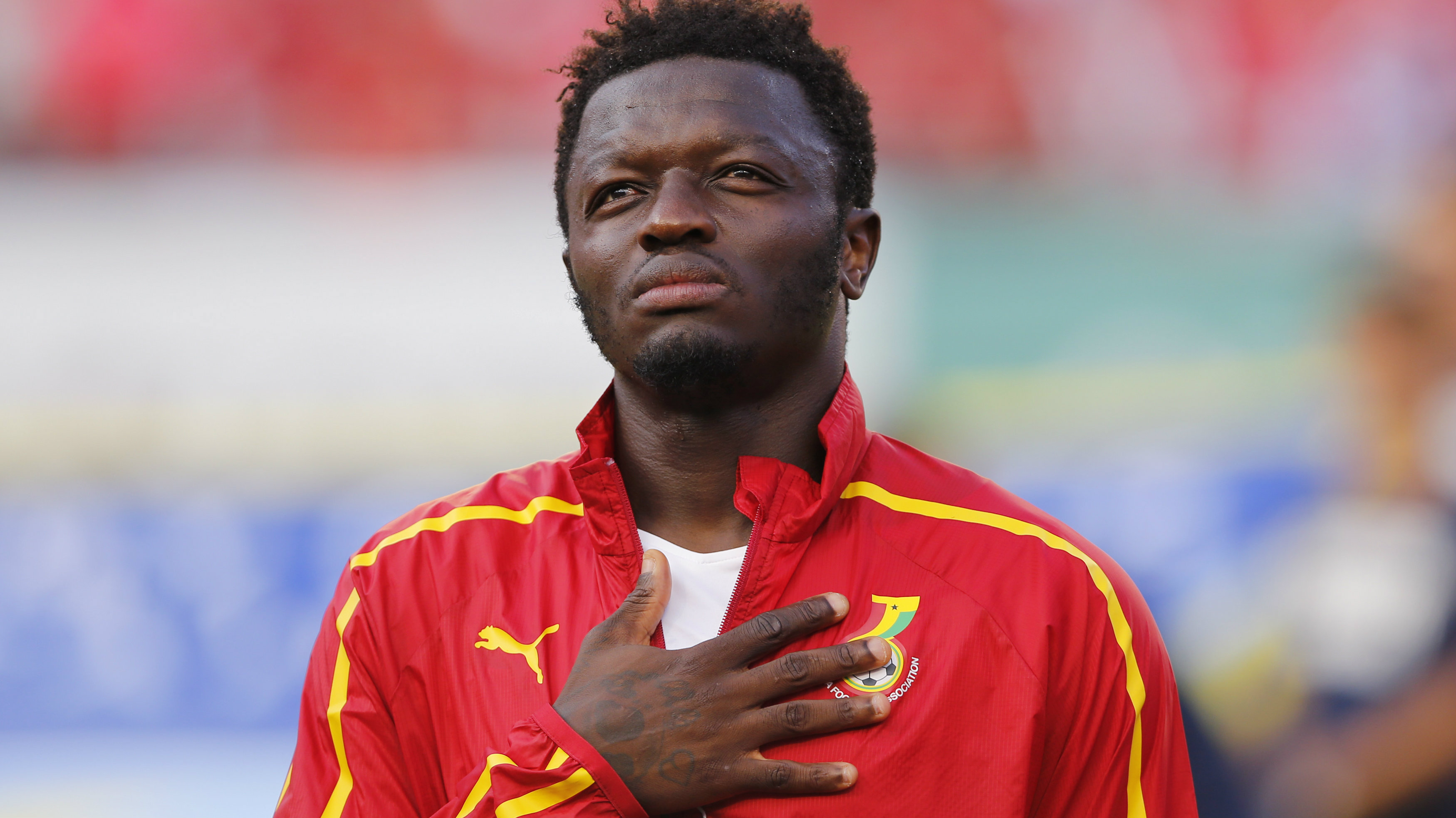 Ghana's Sulley Muntari listens to his country's national anthem before their international soccer friendly against South Korea at Sun Life stadium ahead of the 2014 World Cup in Miami, June 9, 2014
