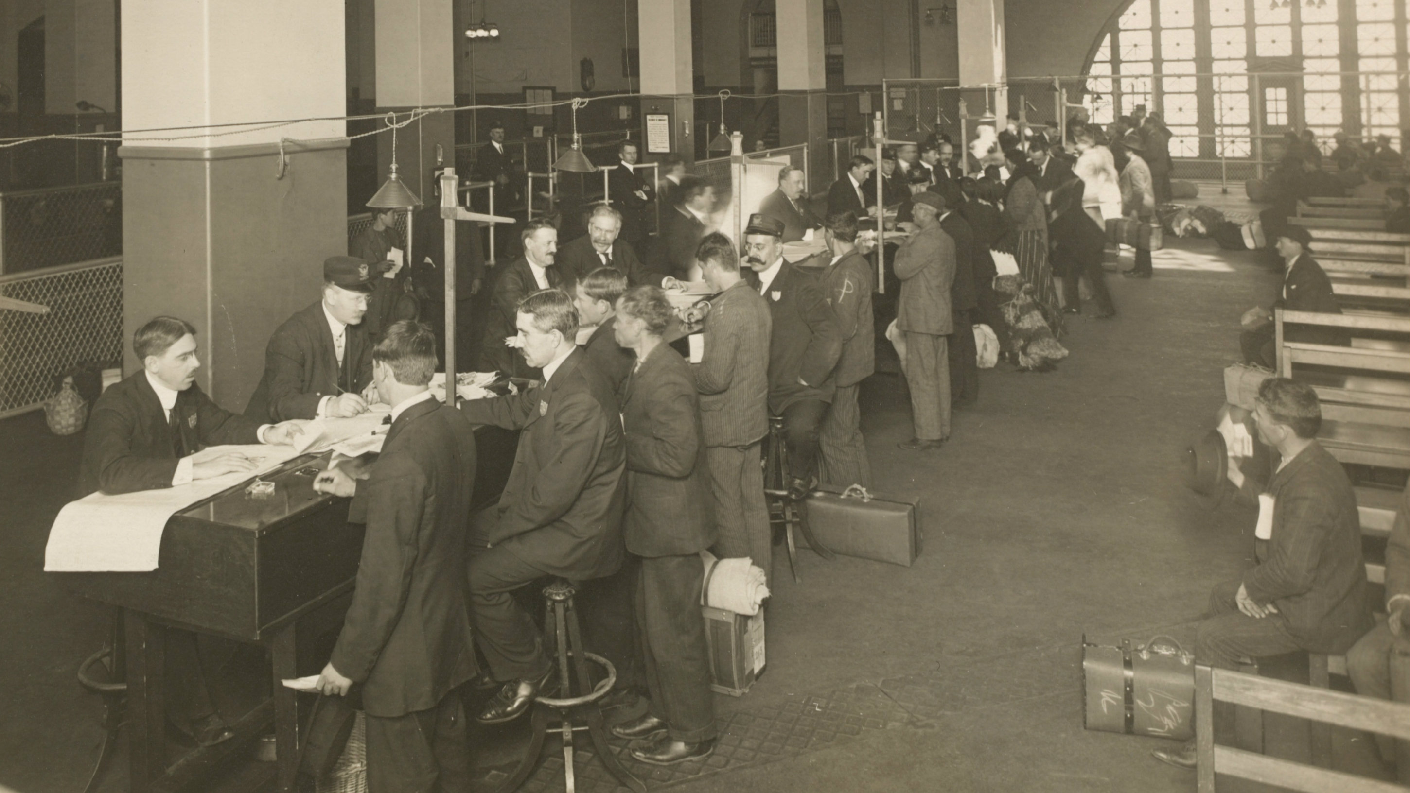 Immigrants being registered at Ellis Island.