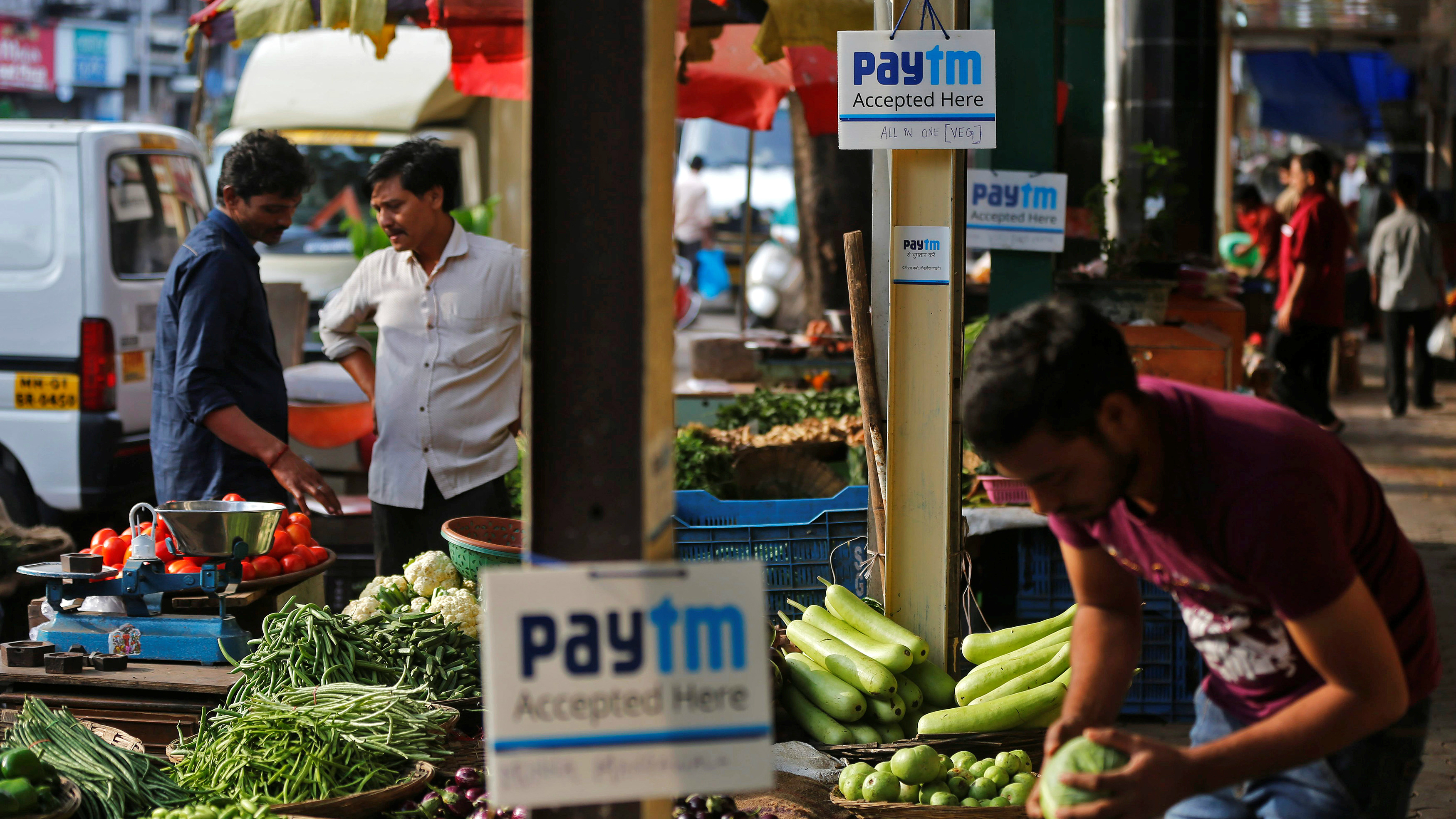 2016Advertisement boards of Paytm, a digital wallet company, are seen placed at stalls of roadside vegetable vendors as they wait for customers in Mumbai, India, November 19, 2016. Picture taken November 19, 2016. REUTERS/Shailesh Andrade