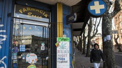 A pharmacy displays a sign at the front door telling clients that they do not have marijuana for sale