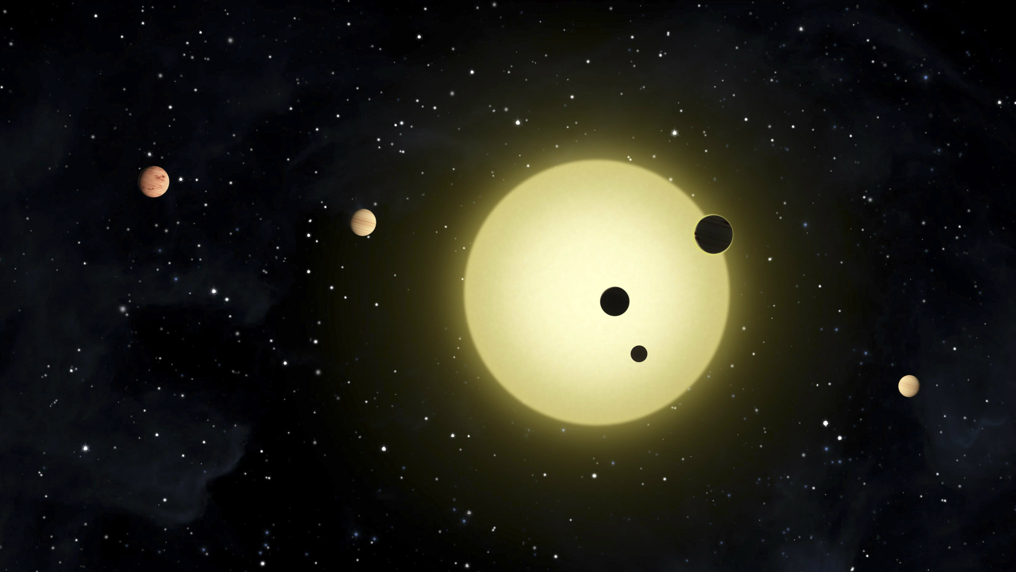 In this artist's conception released by NASA February 2, 2011, Kepler-11 is a sun-like star around which six planets orbit. At times, two or more planets pass in front of the star at once, as shown in a simultaneous transit of three planets observed by NASA's Kepler spacecraft on August 26, 2010. REUTERS/Tim Pyle/NASA/Handout (UNITED STATES - Tags: SCI TECH) FOR EDITORIAL USE ONLY. NOT FOR SALE FOR MARKETING OR ADVERTISING CAMPAIGNS. THIS IMAGE HAS BEEN SUPPLIED BY A THIRD PARTY. IT IS DISTRIBUTED, EXACTLY AS RECEIVED BY REUTERS, AS A SERVICE TO CLIENTS