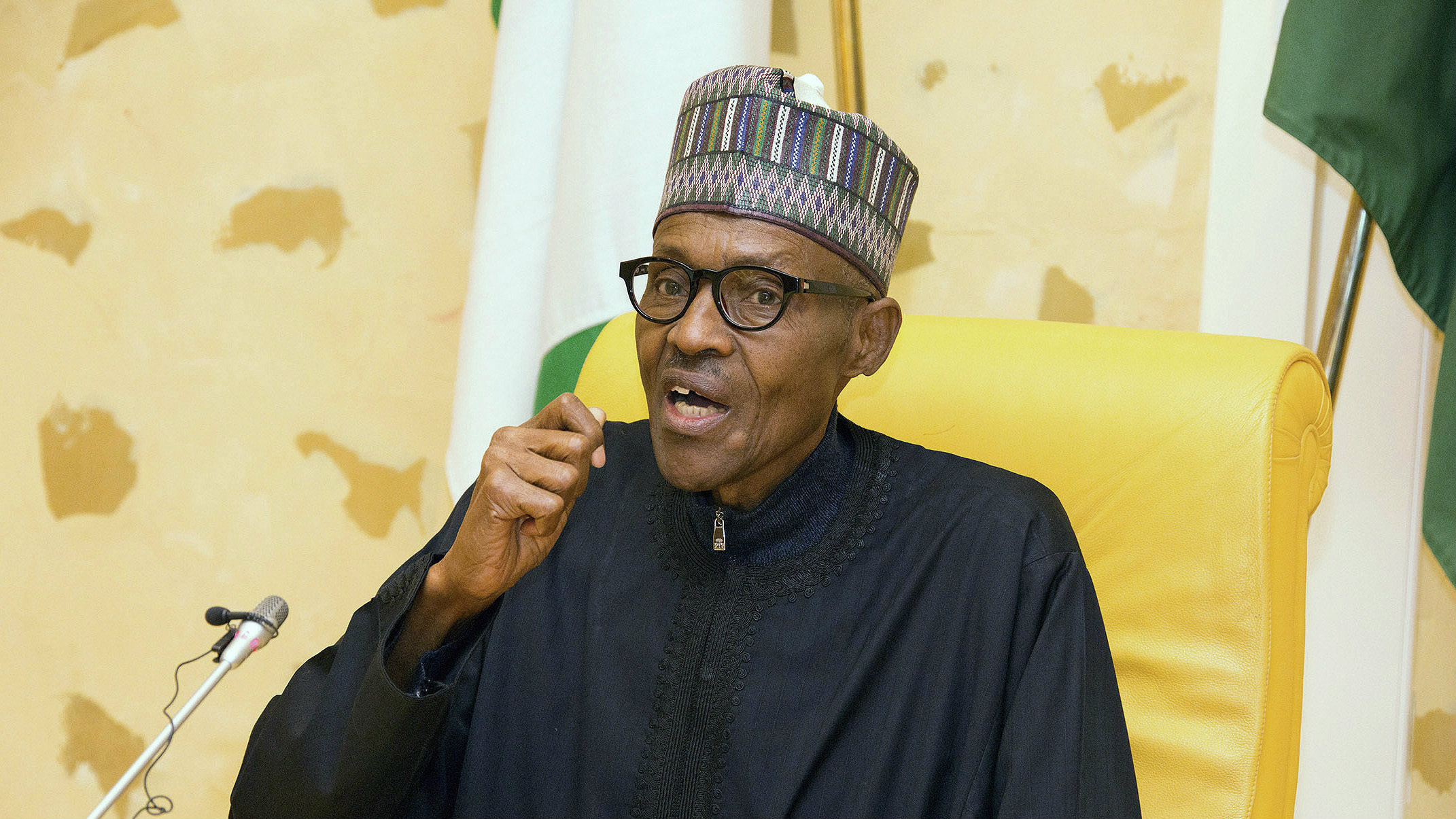 In this photo released by the Nigeria State House, Nigeria President Muhammadu Buhari, speaks at the presidential palace upon his arrival from medical vacation in Abuja, Nigeria, Friday, March 10, 2017. Nigerian President Muhammadu Buhari returned to the country on Friday after a medical leave of a month and a half that raised questions about his health and some calls for his replacement, but he made clear that whatever was ailing him was not yet over.