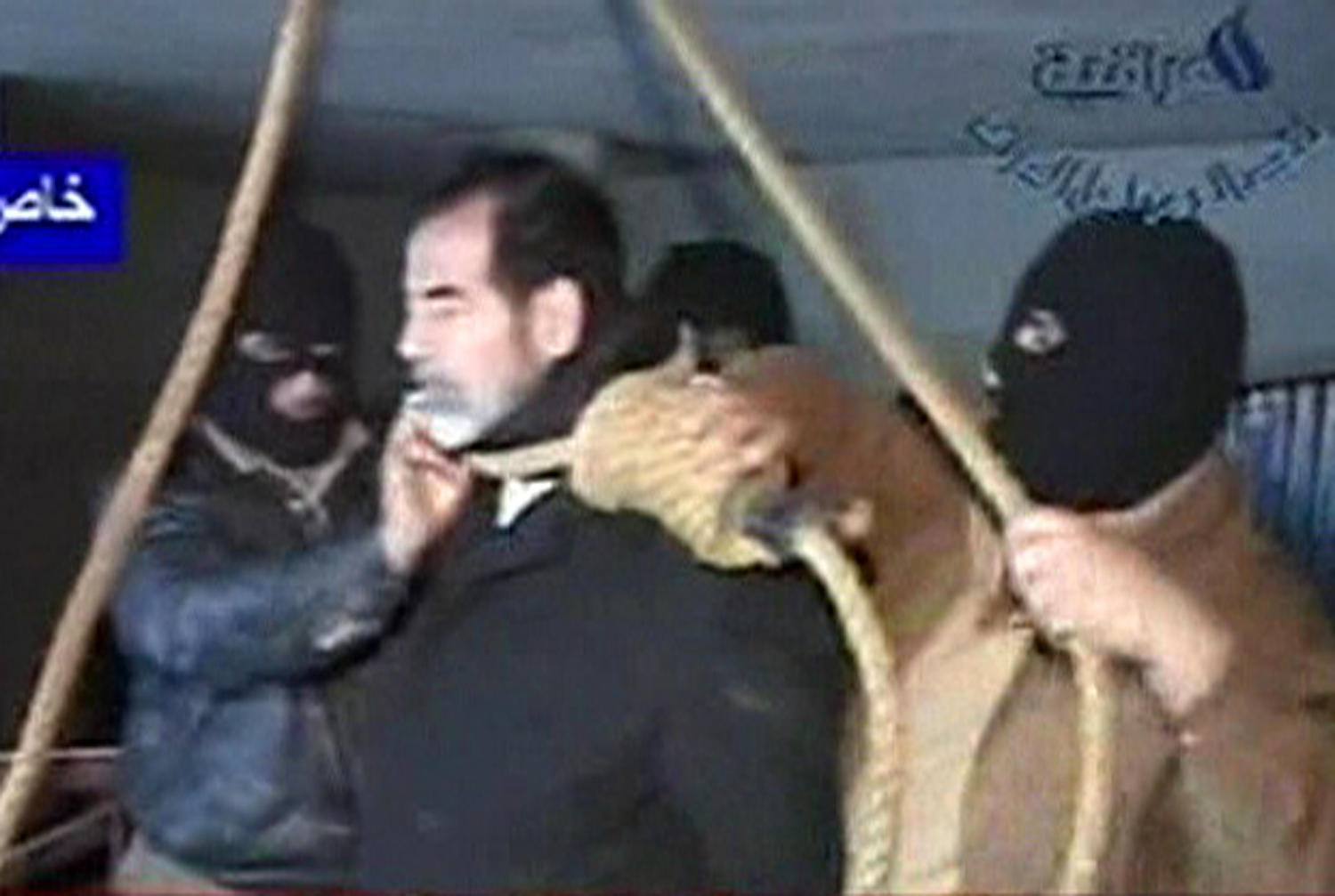 Footage from Al Iraqiya television shows masked executioners putting a noose around former Iraqi President Saddam Hussein's neck moments before his hanging in Baghdad December 30, 2006. Saddam was hanged for crimes against humanity at dawn on Saturday, a dramatic, violent end for a leader who ruled Iraq by fear for three decades before he was toppled by a U.S. invasion four years ago.