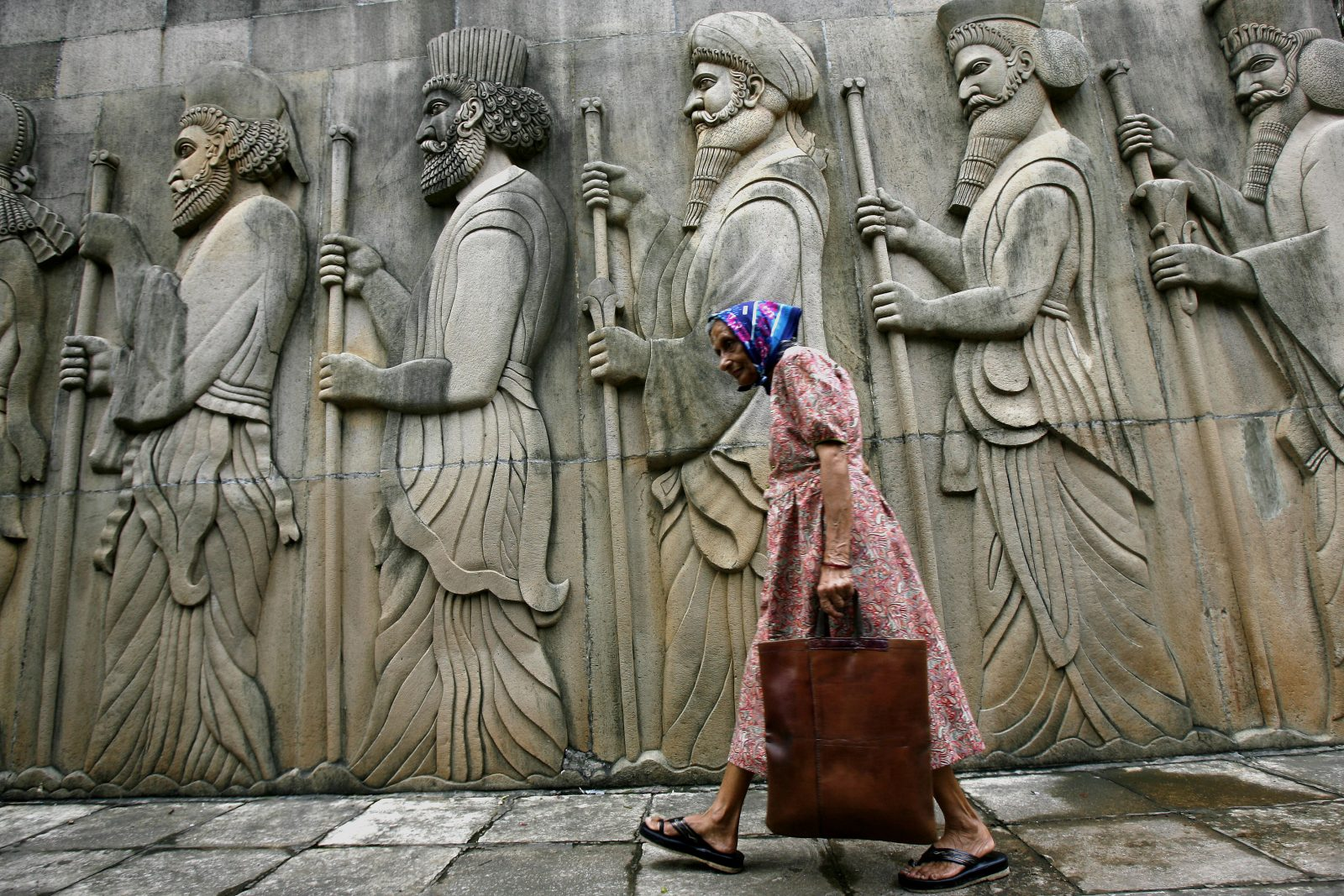 A devotee enters a Parsi fire temple on Parsi New Year day in Mumbai August 19, 2008. The Parsis, descendants of Persian Zoroastrians, emigrated to the Indian subcontinent more than 1000 years ago to escape religious persecution after the Islamic conquest.