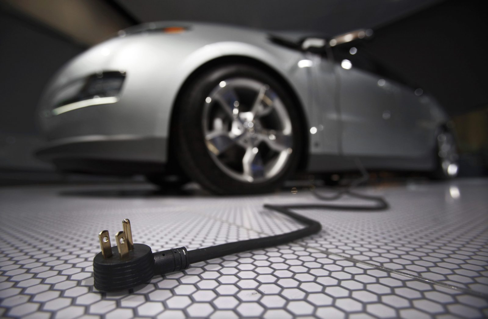 A plug is seen coming from the Chevrolet Volt electric car during the North American International Auto Show in Detroit, Michigan January 13, 2009.