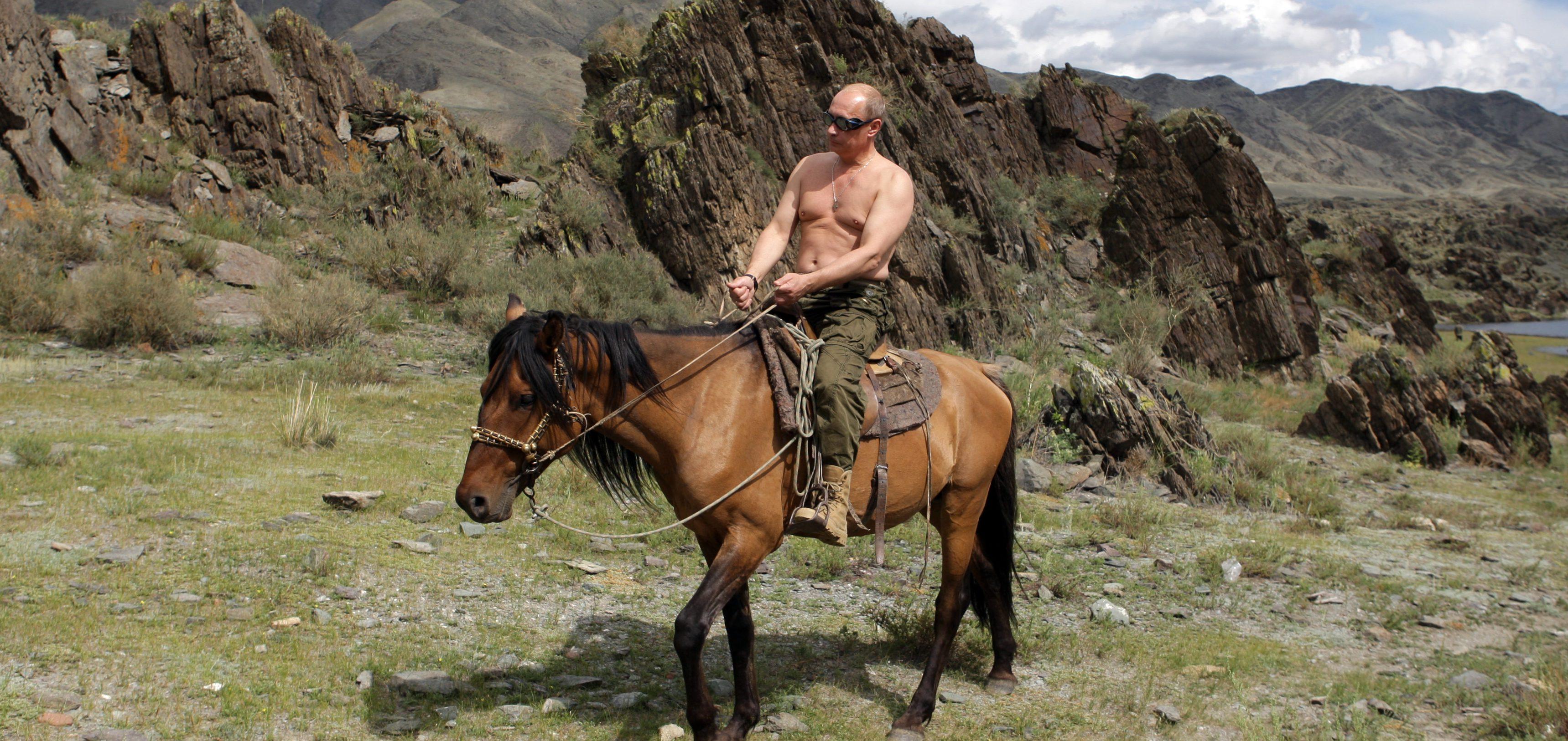 Russia's Prime Minister Putin rides a horse in southern Siberia's Tuva region