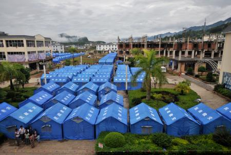 A general view shows temporary tents set up for refugees from Kokang in Myanmar's Shan State at the border town of Nansan, China's Yunnan province, August 30, 2009.