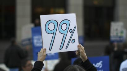 A protestor holding a 99% sign.
