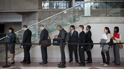 Young job hopefuls wait in line at job fair.