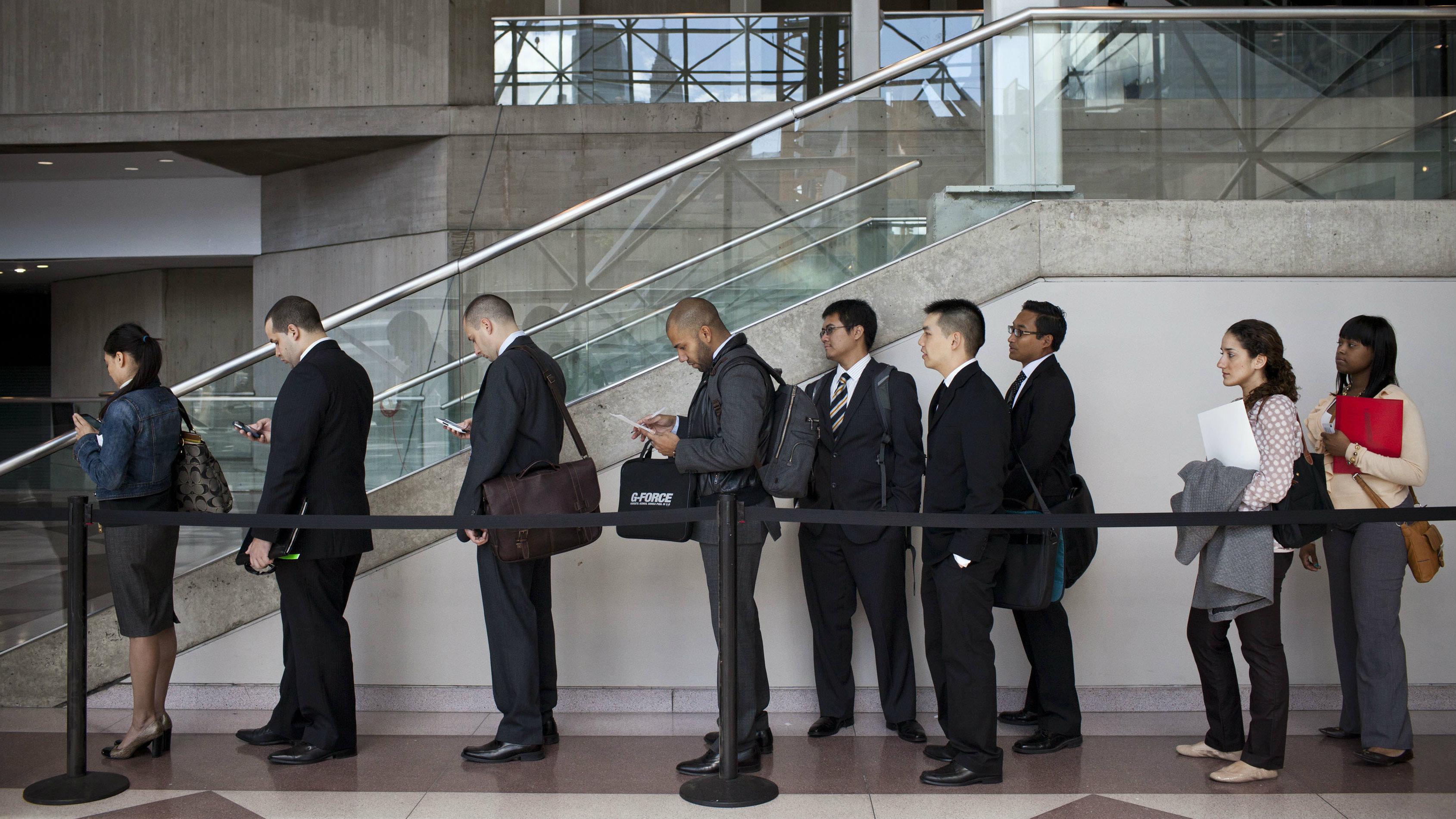 Young job hopefuls wait in line at job fair.