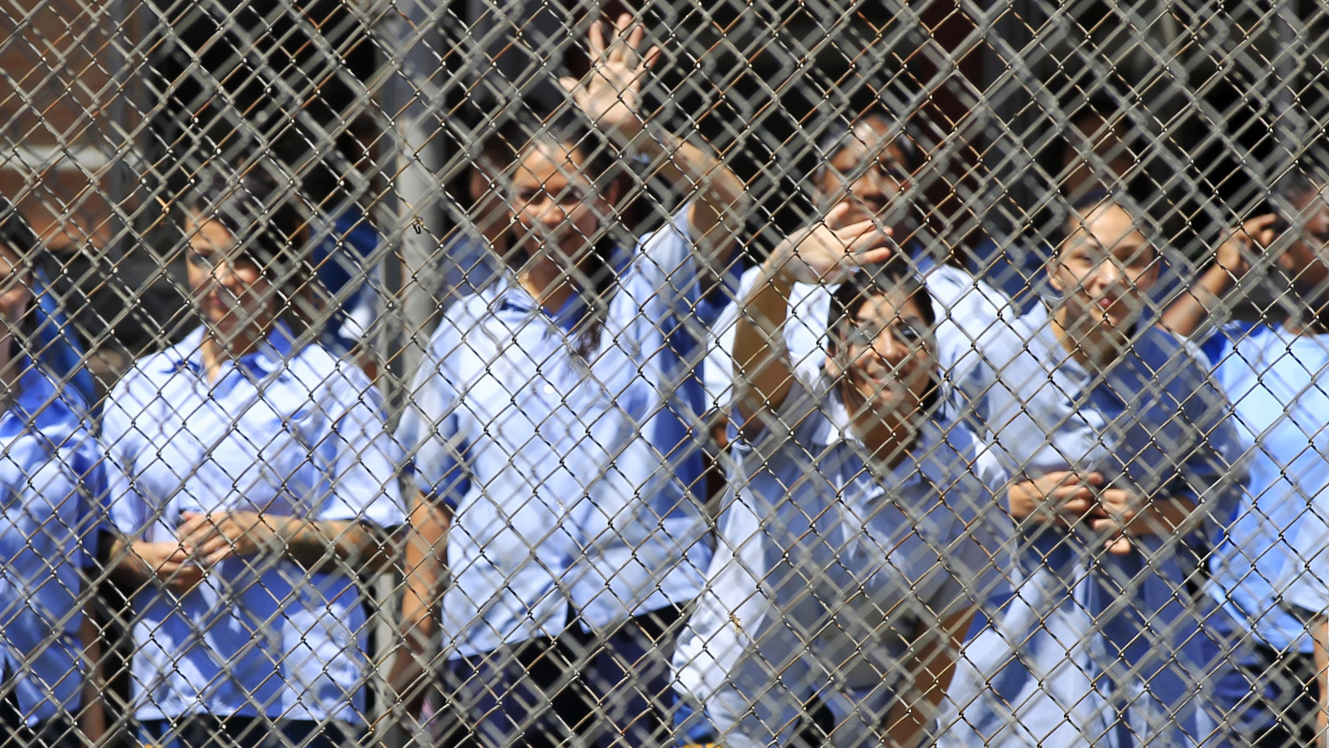 Mothers watch their children arrive to visit at California Institute for Women state prison in Chino, California May 5, 2012.  An annual Mother's Day event, Get On The Bus, brings children in California to visit their mothers in prison. Sixty percent of parents in state prison report being held over 100 miles (161 km) from their children.  Picture taken May 5, 2012          REUTERS/Lucy Nicholson (UNITED STATES - Tags: CRIME LAW SOCIETY) ATTENTION EDITORS PICTURE 01 OF 28 FOR PACKAGE 'MOTHER'S DAY BEHIND BARS' - RTR31WCK